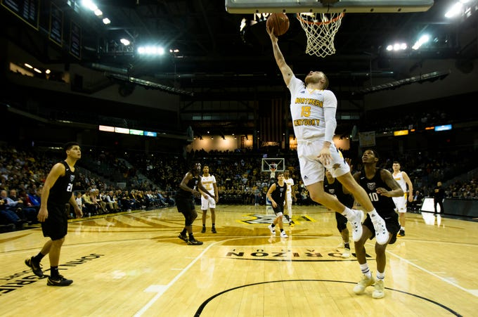 Northern Kentucky Norse guard Tyler Sharpe (15) hits a layup in the second half of the men's NCAA basketball game between Northern Kentucky Norse and Oakland Golden Grizzlies on Saturday, Feb. 9, 2019, at BB&T Arena in Highland Heights, Ky. Northern Kentucky Norse defeated Oakland Golden Grizzlies 79-64.