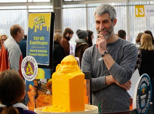Jimmy Bonamino of Jungle Jim's smiles as Sarah Kaufman shows a young girl the start of a cheese sculpture at the Big Cheese Festival, at Jungle Jim's International Market, Saturday, Feb. 9, 2019.
