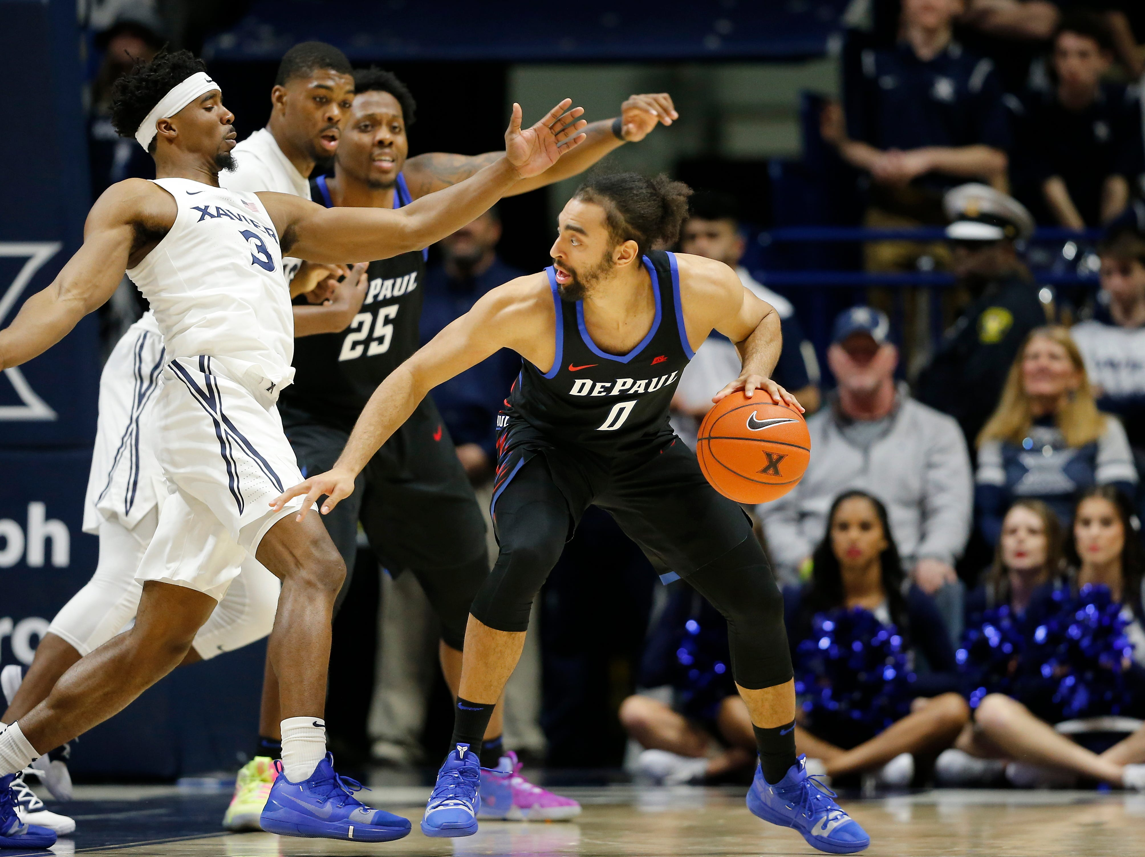 DePaul Blue Demons guard Lyrik Shreiner (0) drives against Xavier Musketeers guard Quentin Goodin (3) in the second half of the NCAA Big East Conference game between the Xavier Musketeers and the DePaul Blue Demons at the Cintas Center in Cincinnati on Saturday, Feb. 9, 2019. Xavier lost its sixth game in a row, 74-62.