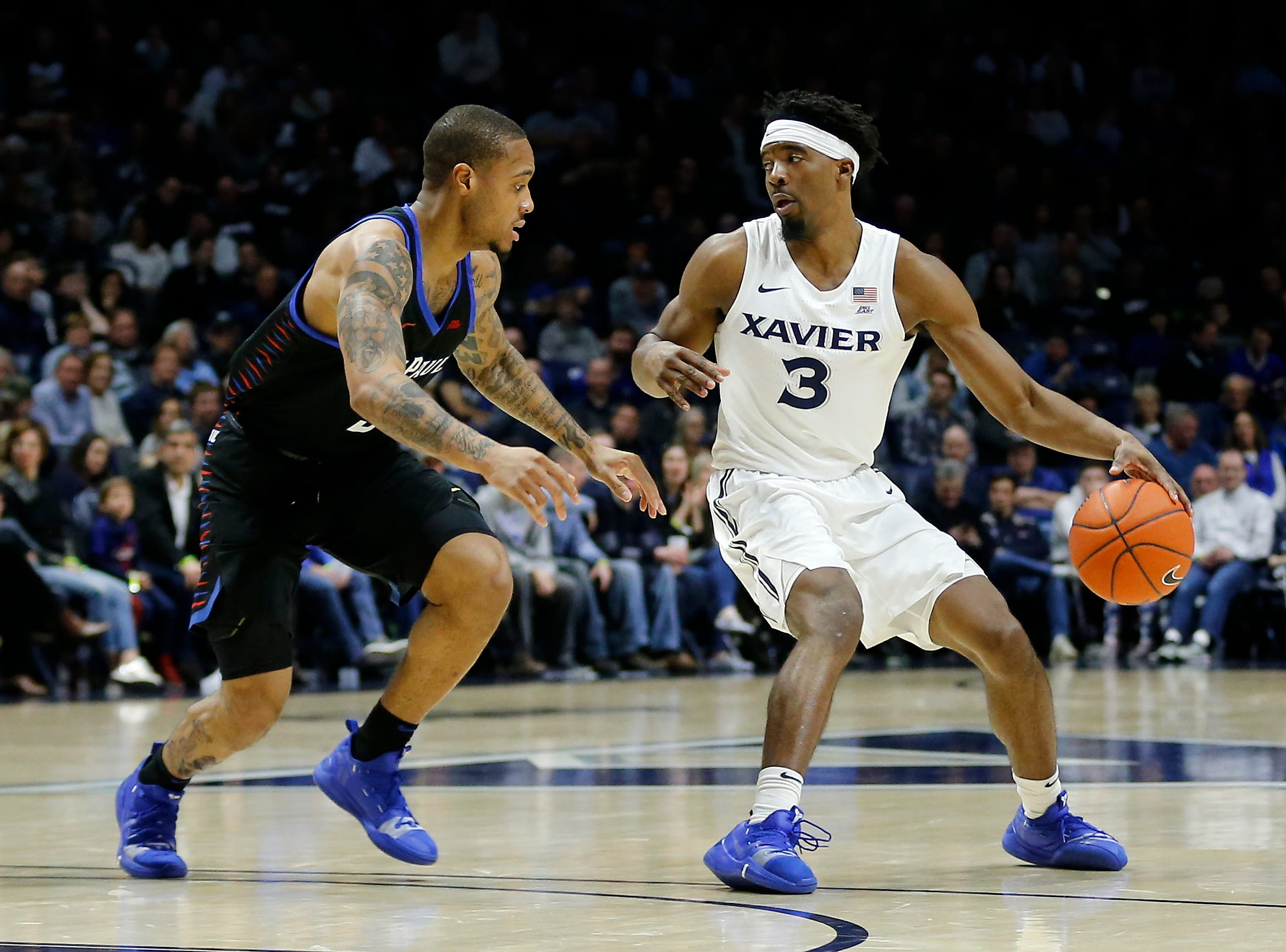 Xavier Musketeers guard Quentin Goodin (3) drives against DePaul Blue Demons guard Devin Gage (3) in the first half of the NCAA Big East Conference game between the Xavier Musketeers and the DePaul Blue Demons at the Cintas Center in Cincinnati on Saturday, Feb. 9, 2019.