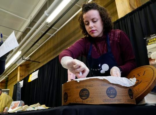 Emilie Massardier prepares samples of Gorgonzla Dolce at Fromi's booth at the annual Big Cheese Festival, at Jungle Jim's International Market, Saturday, Feb. 9, 2019. A native of Comte, France, she works with specialty imported cheeses.