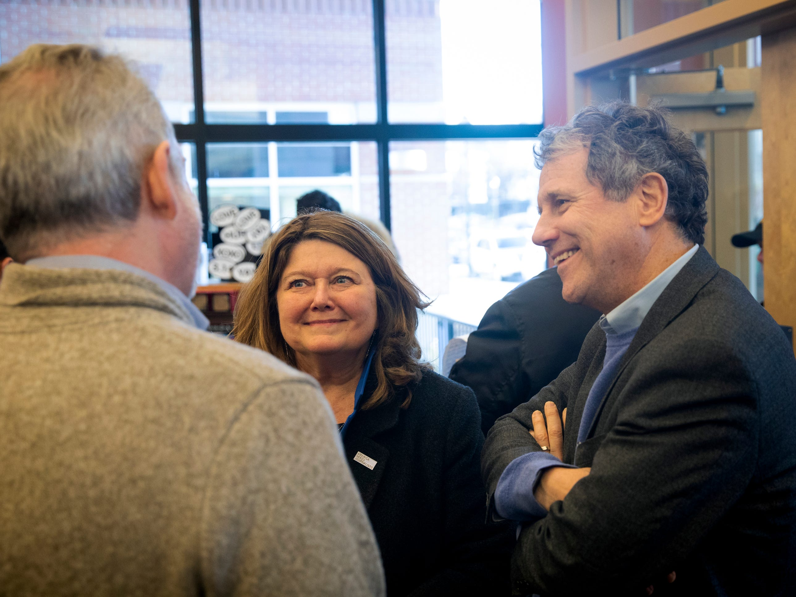 Michael Herrmann, the owner of Gibson's Bookstore, greets  Senator Sherrod Brown and his wife Connie Schultz before Brown does a meet and greet at Gibson's Bookstore in Concord, N.H. Saturday, February 9, 2019.