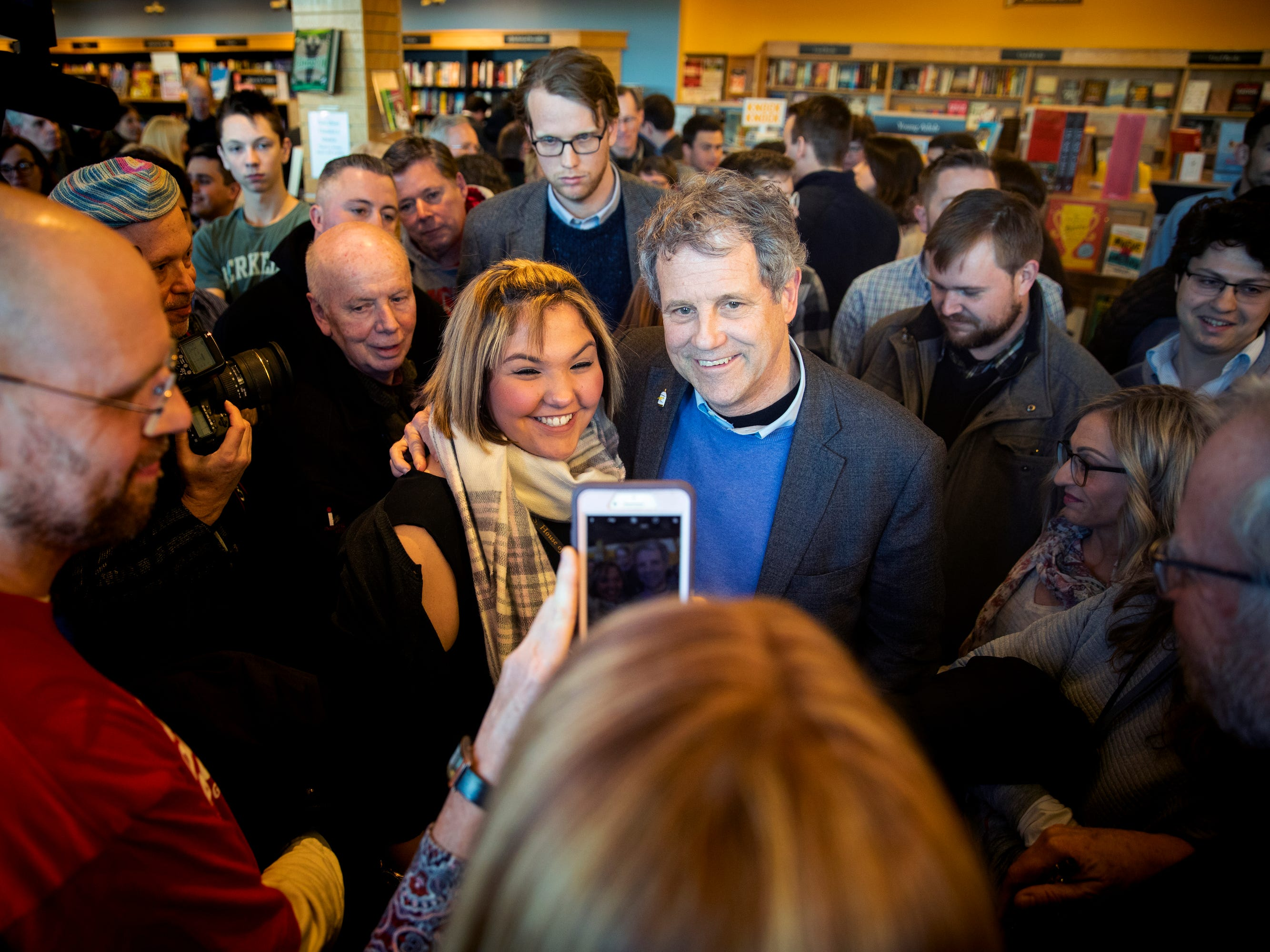 Senator Sherrod Brown poses for pictures with people during a meet and greet at Gibson's Bookstore in Concord, N.H. Saturday, February 9, 2019. Brown is considering a presidential run. He visited Iowa last week and will travel to Nevada and South Carolina in the next few weeks.