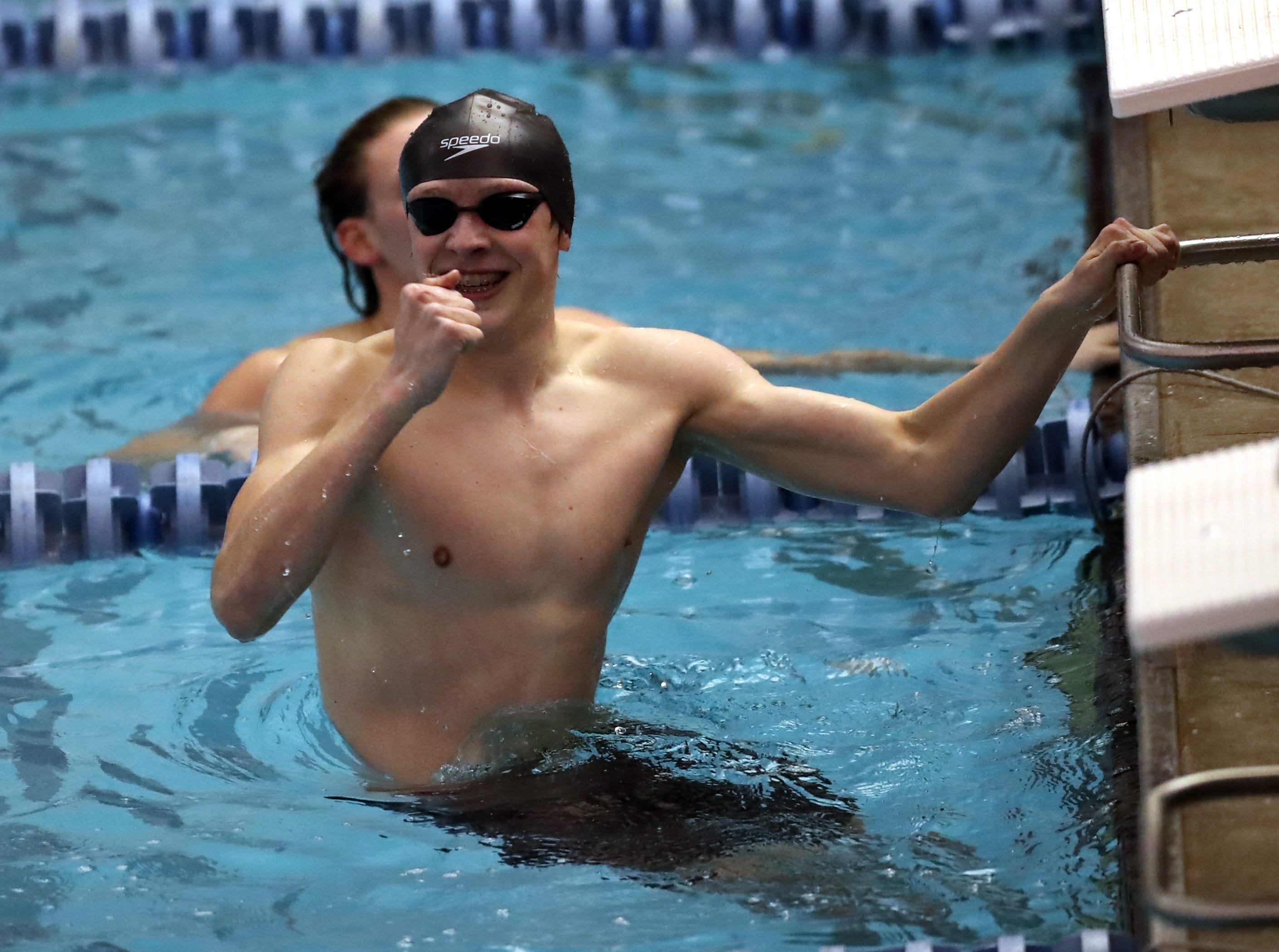 Jack Banks from Highlands reacts as he wins the Boys 100 Yard Butterfly at the Regional Final at the KHSAA Regional Swimming Finals in Erlanger, Kentucky.