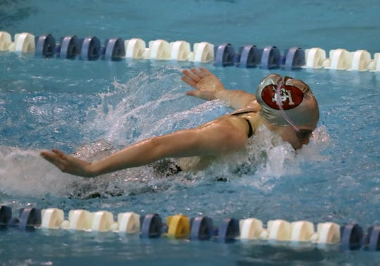 Kenady Beil from Dixie Heights wins the Girls 100 Yard Butterfly at the Regional Final at the KHSAA Regional Swimming Finals in Erlanger, Kentucky.