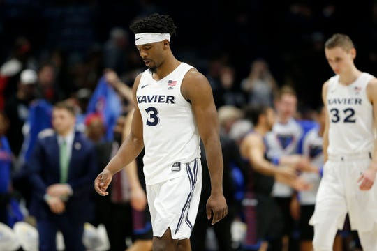 Xavier Musketeers guard Quentin Goodin (3) returns to the sideline after the second half of the NCAA Big East Conference game between the Xavier Musketeers and the DePaul Blue Demons at the Cintas Center in Cincinnati on Sunday, Feb. 10, 2019. Xavier lost its sixth game in a row, 74-62.