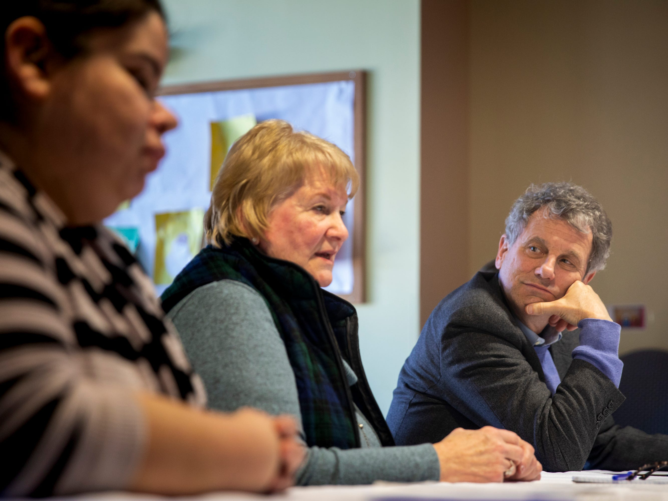 Senator Sherrod Brown listens to Anne Grassie talk about the affects of the opioid epidemic on childcare during a roundtable with caregiving professionals at Lakes Region Child Care in Laconia, N.H. Saturday, February 9, 2019.