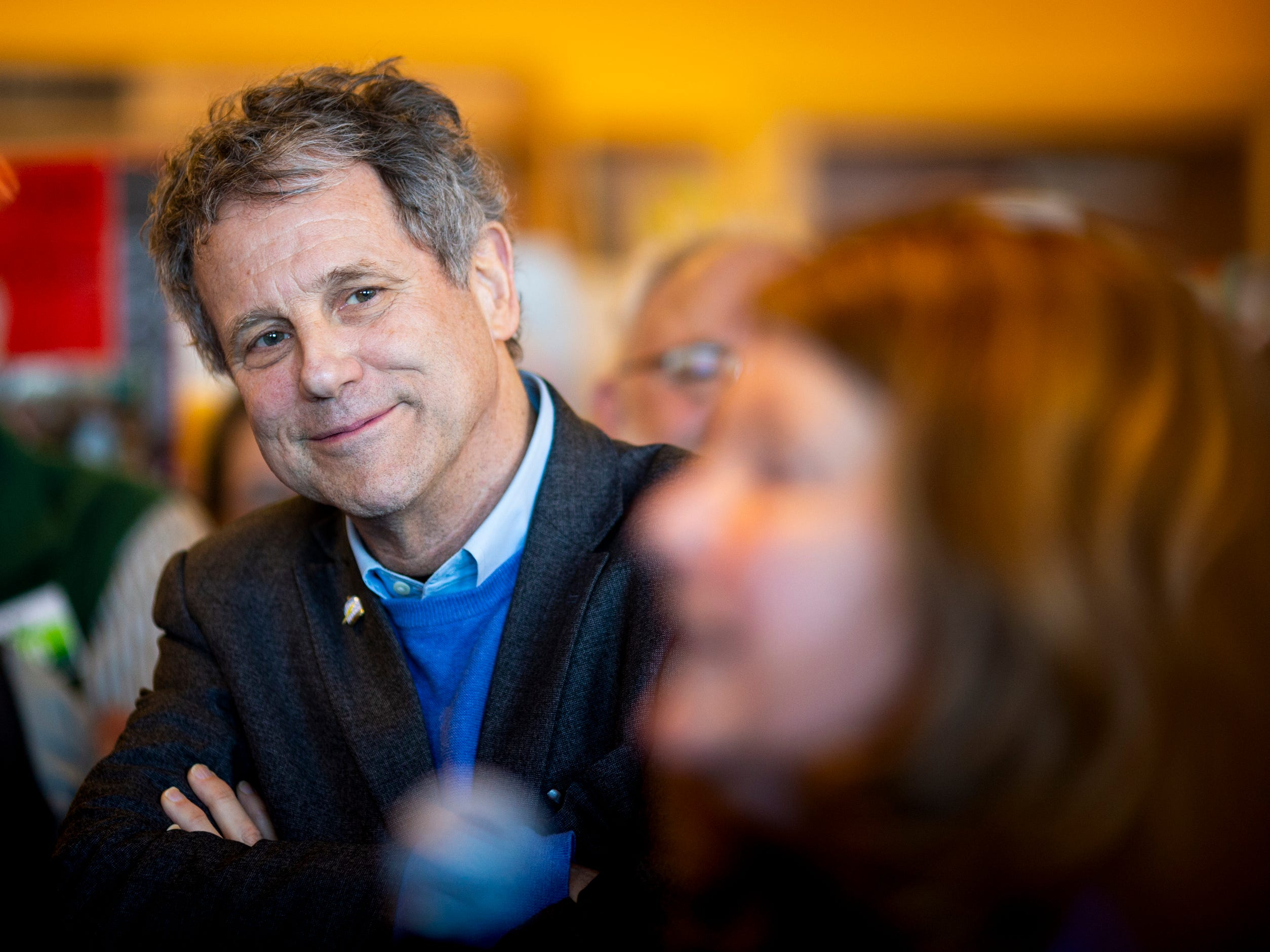 Senator Sherrod Brown listens to his wife Connie Schultz tell the story about how she checked his voting record before they went out on a first date to a large crowd during a meet and greet at Gibson's Bookstore in Concord, N.H. Saturday, February 9, 2019.