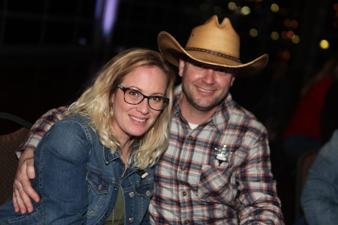 Sandy and Mark Wojnarek smile during the annual Crime Stoppers Blue Jean Ball at Wilma Rudolph Event Center, on Saturday, Feb. 9, 2019.