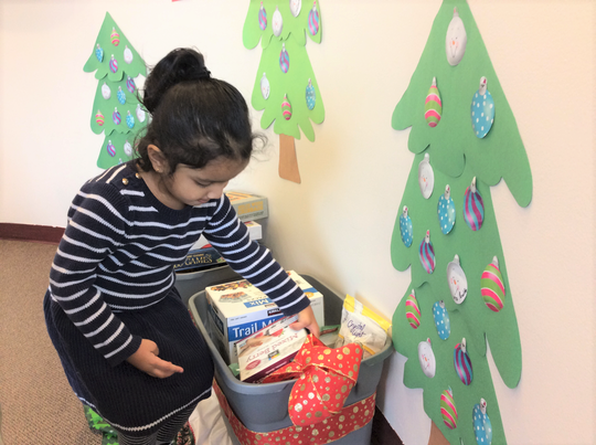 Montessori Corner students donate more than 240 pounds of food and supplies to U.S. Military members