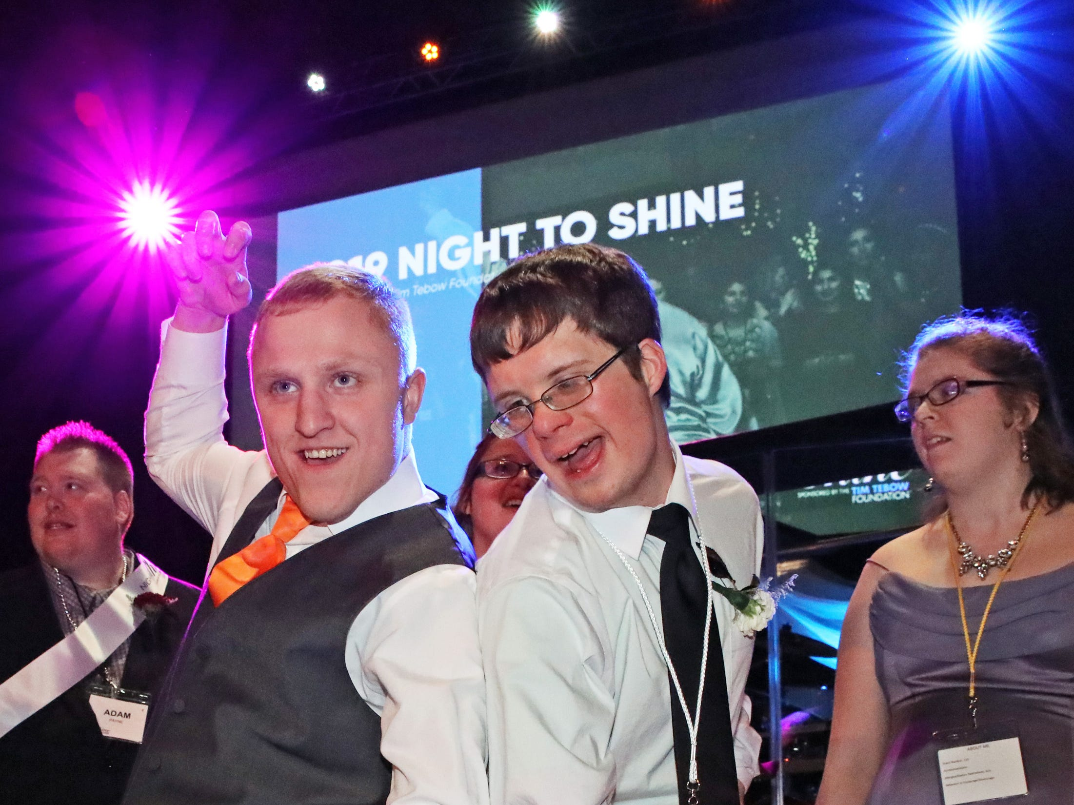 Cole Quinlin, left, and Steven Strennen of Ankeny have a blast at the Night to Shine event at Prairie Ridge Church in Ankeny on Friday, Feb. 8, 2019. Sponsored by the Tim Tebow Foundation, the event for adults with special needs features a prom-like atmosphere with dancing, limo rides, food and more.