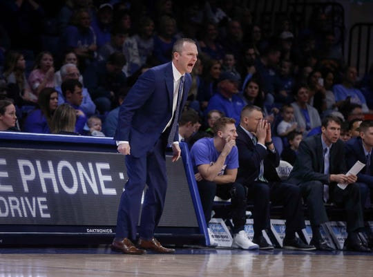 Drake head mens basketball coach Darian DeVries shouts out to his defense in the first half against Northern Iowa at Drake University in Des Moines in on Saturday, Feb. 9, 2019.