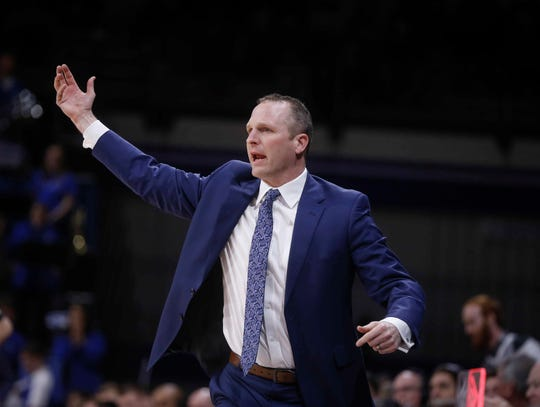 Drake head basketball coach Darian DeVries calls for a play in the first half against Northern Iowa at Drake University in Des Moines in on Saturday, Feb. 9, 2019.
