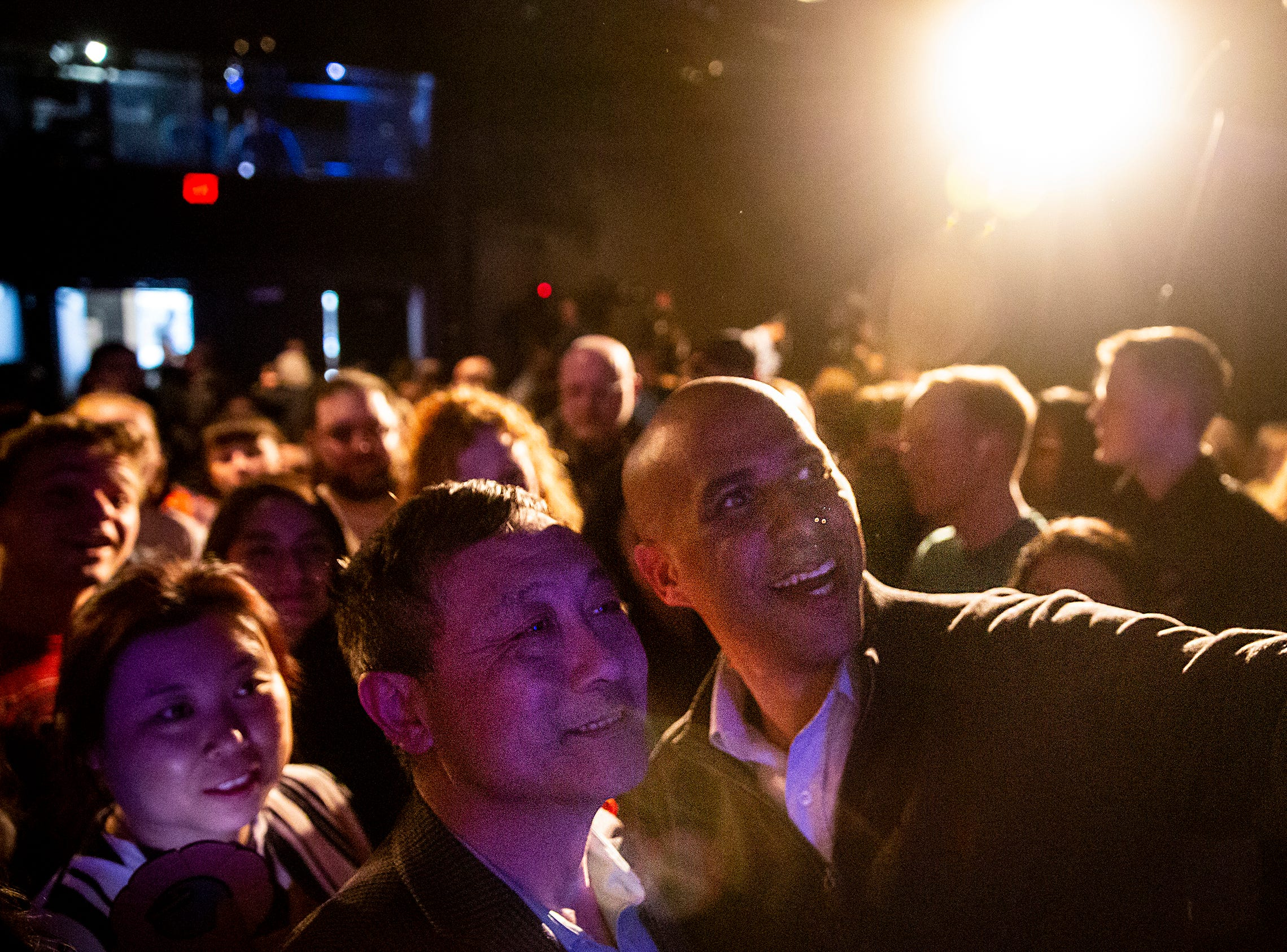 Sen. Cory Booker, D-N.J., takes a selfie with a man in the crowd after speaking to a group of people gathered in the Kum & Go Theater on Saturday, Feb. 9, 2019, in downtown Des Moines. This is Bookers first swing through Iowa after announcing he's running for president.