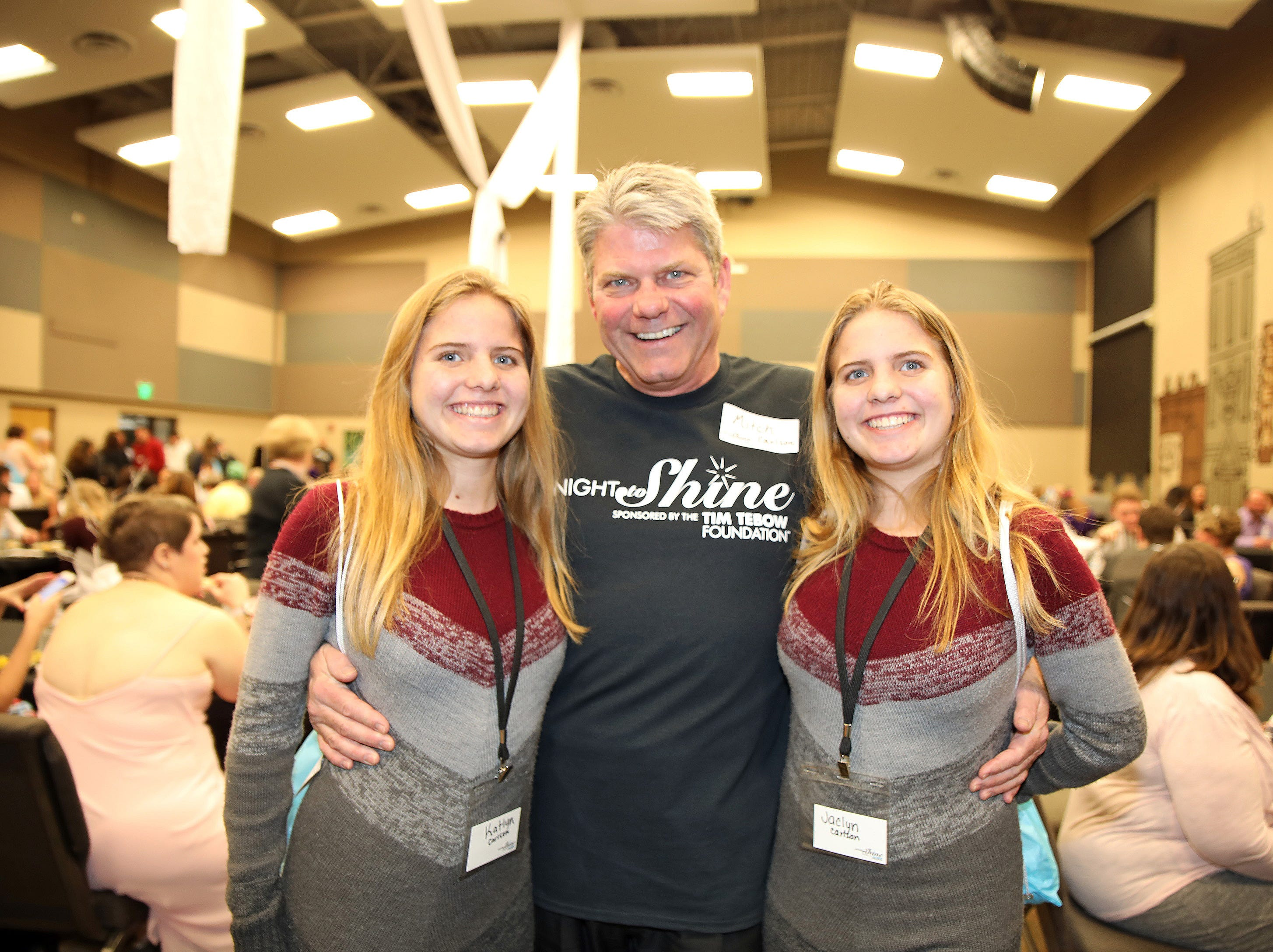 Kati, Mitch and Jaci Carlson of Ankeny volunteer during the Night to Shine event at Prairie Ridge Church in Ankeny on Friday, Feb. 8, 2019. Sponsored by the Tim Tebow Foundation, the event for adults with special needs features a prom-like atmosphere with dancing, limo rides, food and more.