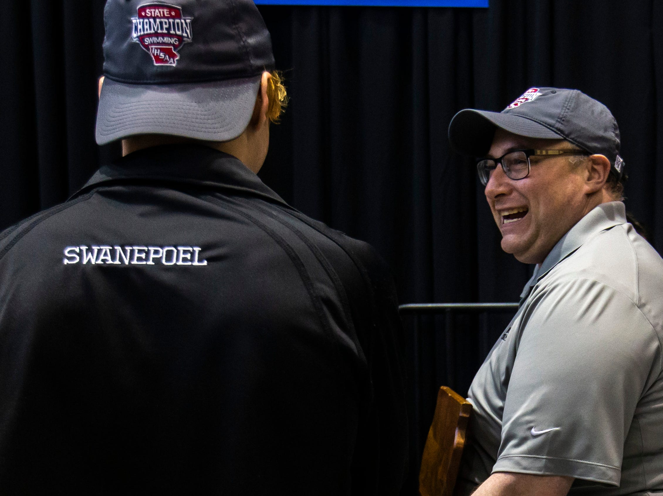 Ankeny coach Justin Crouch talks with swimmers while carrying the coach of the year trophy after the Iowa boys' state swimming regional championship meet on Saturday, Feb. 9, 2019 at Campus Recreation and Wellness Center on the University of Iowa campus in Iowa City, Iowa.
