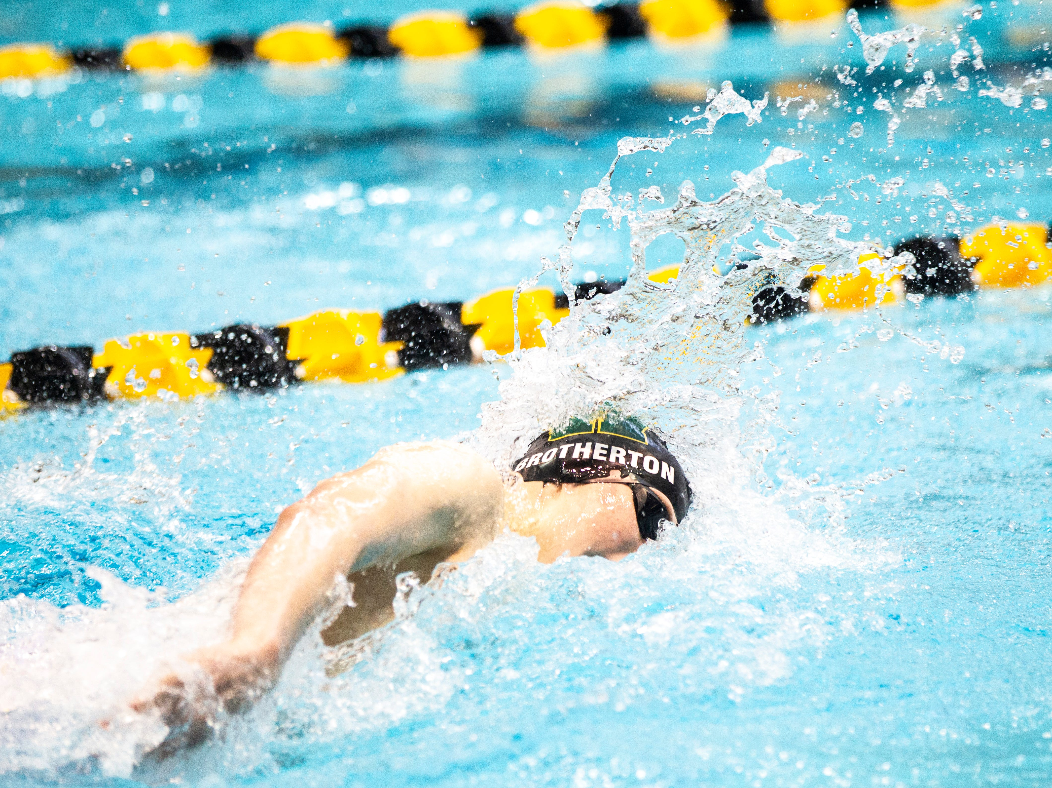 Iowa City West freshman Kirk Brotherton competes in the second heat of 400 yard freestyle relay during the Iowa boys' state swimming regional championship meet on Saturday, Feb. 9, 2019 at Campus Recreation and Wellness Center on the University of Iowa campus in Iowa City, Iowa. West High finished 14th overall, with a time of 3:18.44.