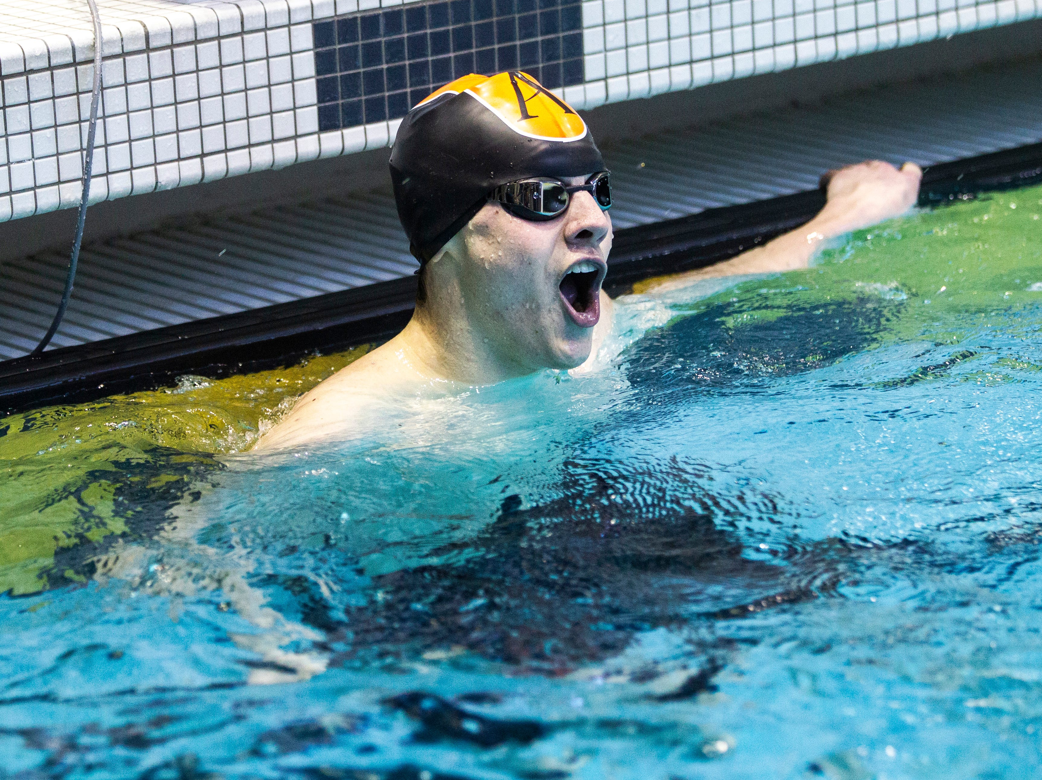 Ames senior Ethan Johnson reacts after winning the first heat of the 200 yard individual medley during the Iowa boys' state swimming regional championship meet on Saturday, Feb. 9, 2019 at Campus Recreation and Wellness Center on the University of Iowa campus in Iowa City, Iowa. Johnson finished 14th overall, with a time of 1:59.95.
