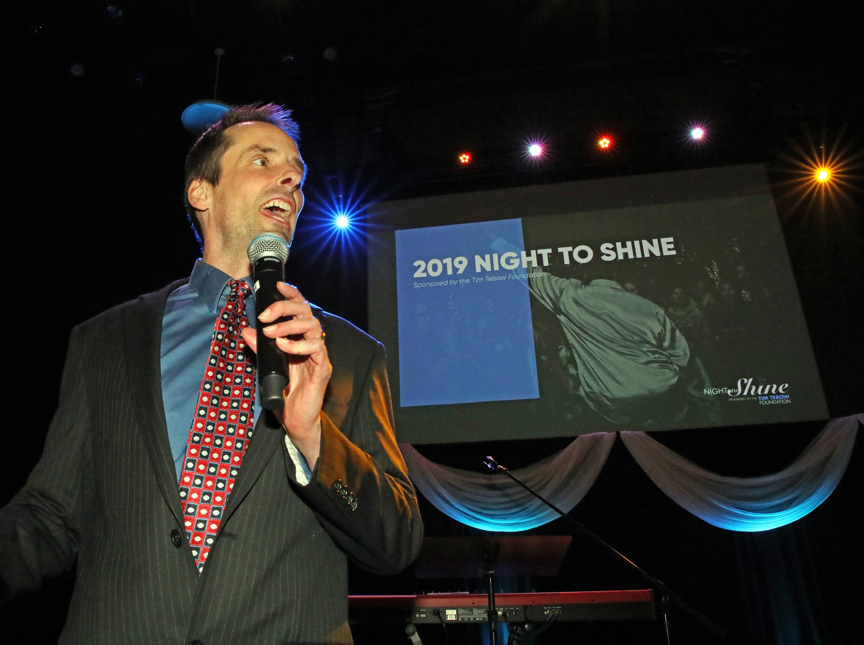 The Rev. Mike Van Rees welcomes everyone to the Night to Shine event at Prairie Ridge Church in Ankeny on Friday, Feb. 8, 2019. Sponsored by the Tim Tebow Foundation, the event for adults with special needs features a prom-like atmosphere with dancing, limo rides, food and more.