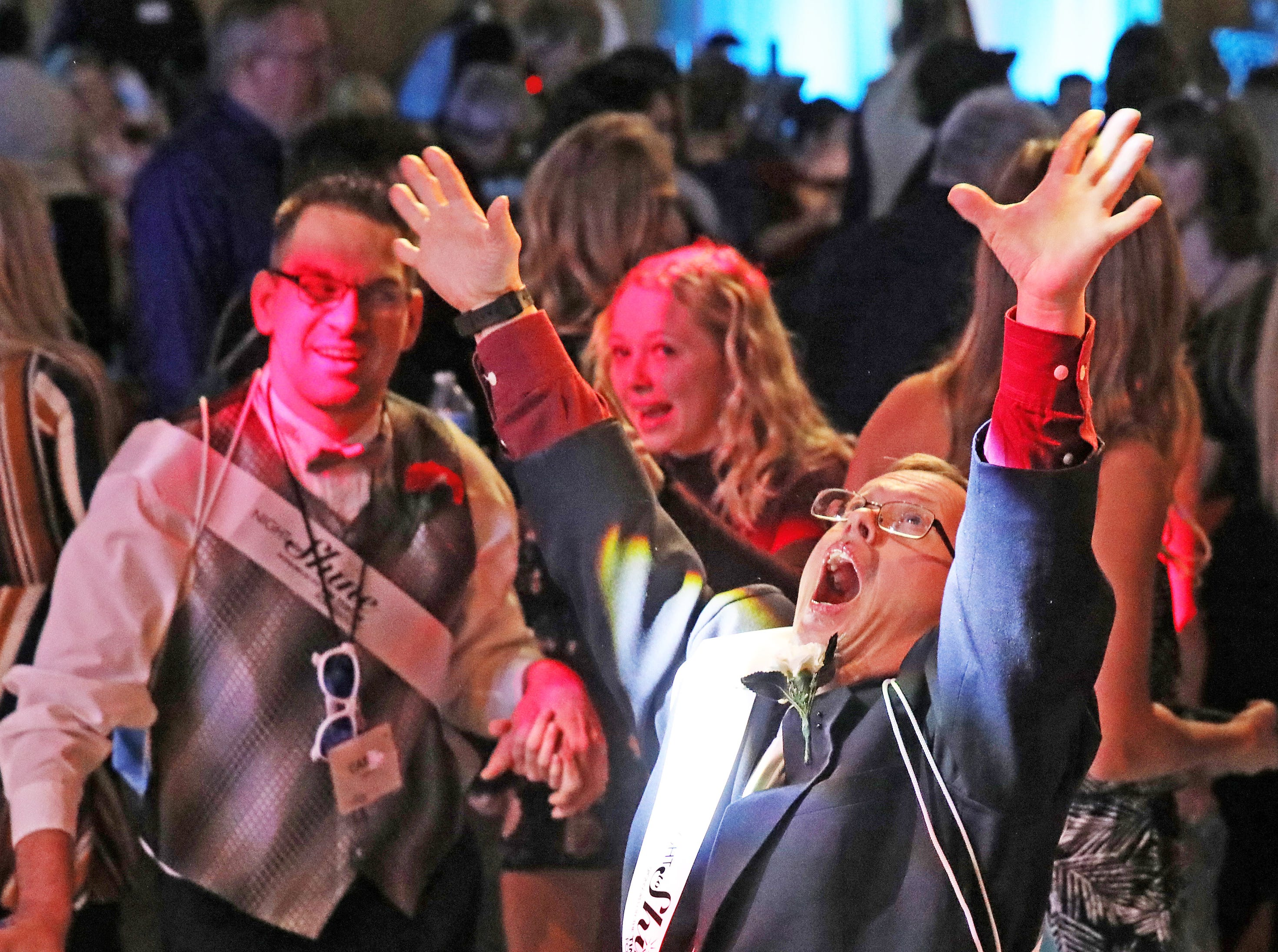 Shawn Flinn dances to Y-M-C-A during the Night to Shine event at Prairie Ridge Church in Ankeny on Friday, Feb. 8, 2019. Sponsored by the Tim Tebow Foundation, the event for adults with special needs features a prom-like atmosphere with dancing, limo rides, food and more.