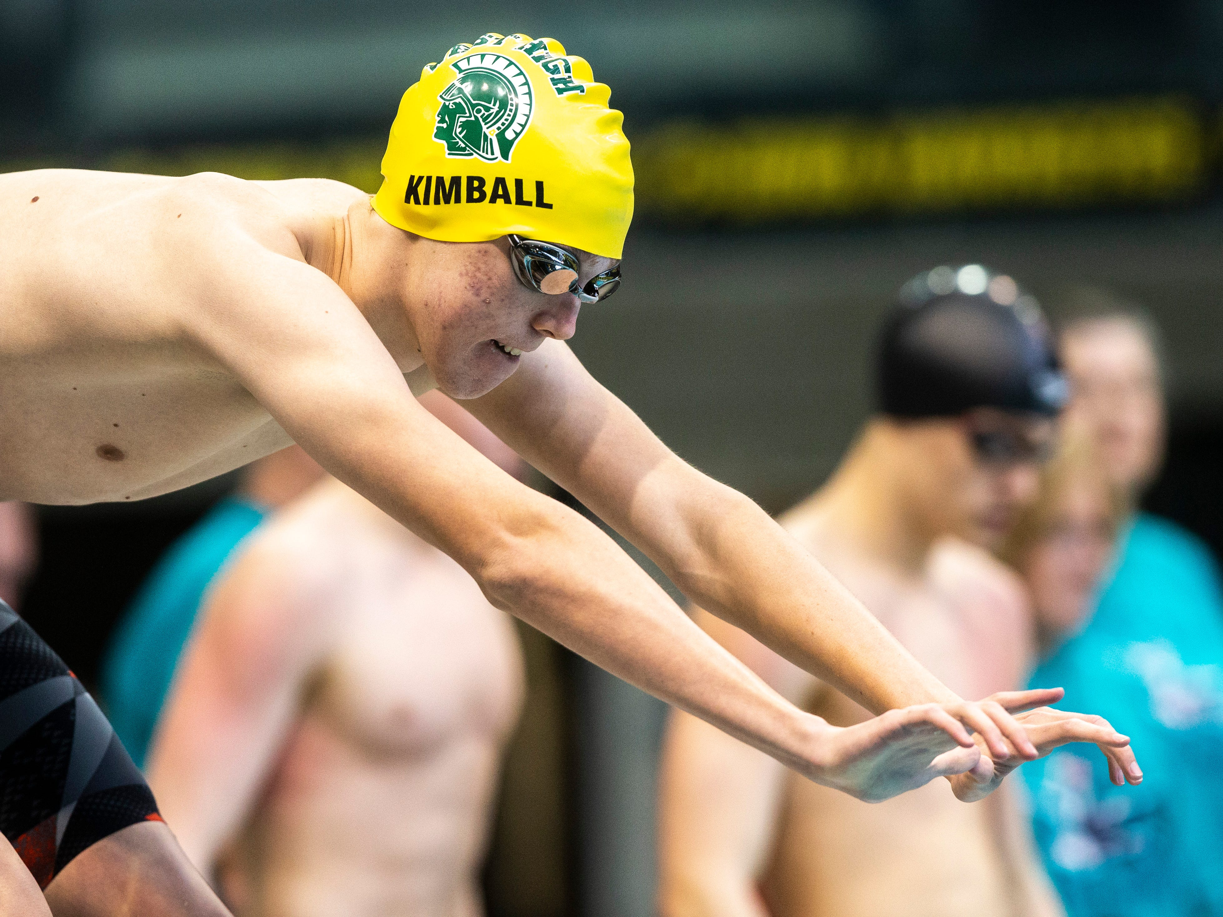 Iowa City West junior Michael Kimball gets set on the blocks in the third heat of 200 yard freestyle relay during the Iowa boys' state swimming regional championship meet on Saturday, Feb. 9, 2019 at Campus Recreation and Wellness Center on the University of Iowa campus in Iowa City, Iowa.