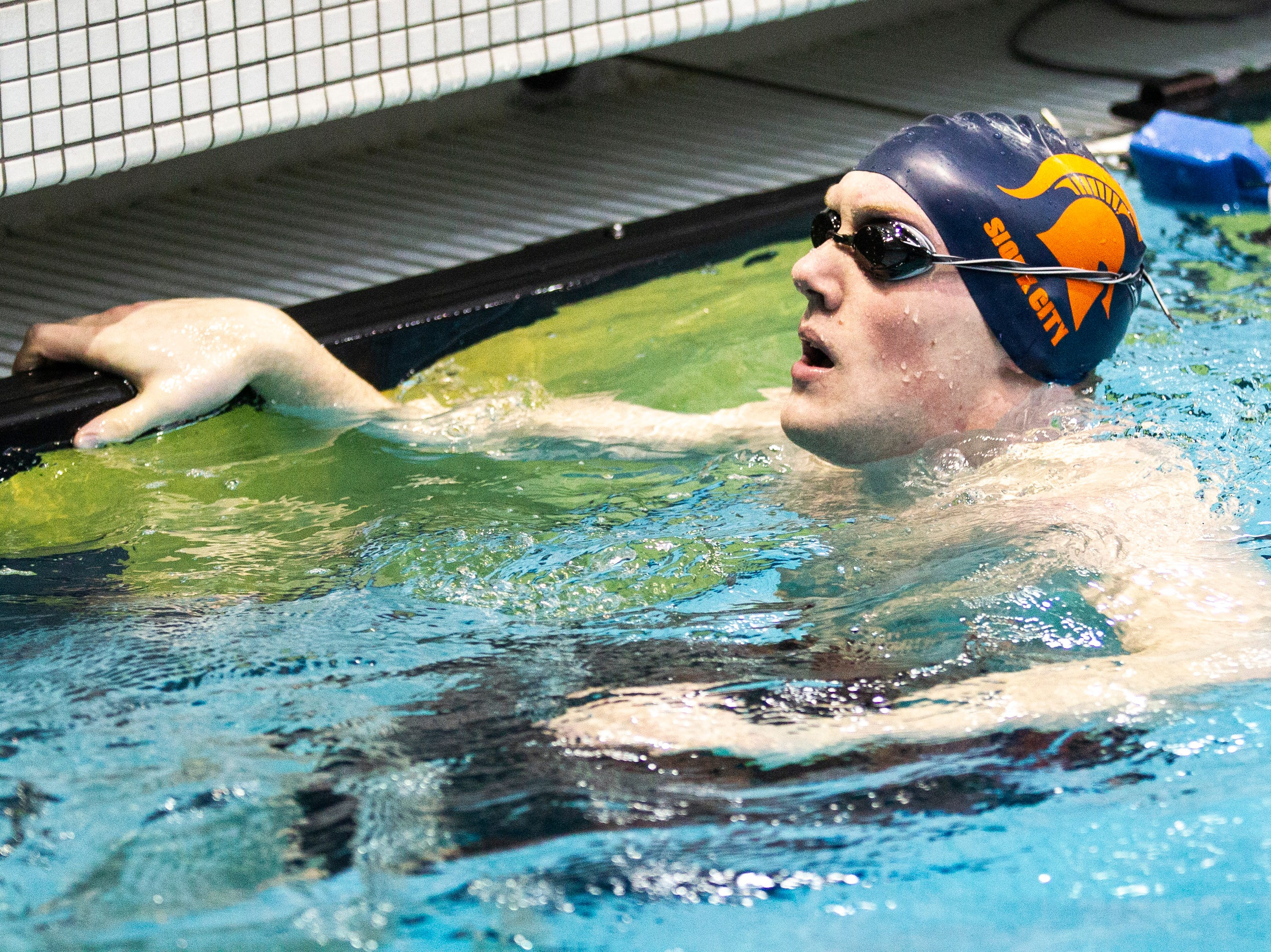 Sioux City Metro senior William Rankin reacts after finish second in the second heat of 400 yard freestyle relay during the Iowa boys' state swimming regional championship meet on Saturday, Feb. 9, 2019 at Campus Recreation and Wellness Center on the University of Iowa campus in Iowa City, Iowa. Sioux City Metro finished eighth overall, with a time of 3:14.49.