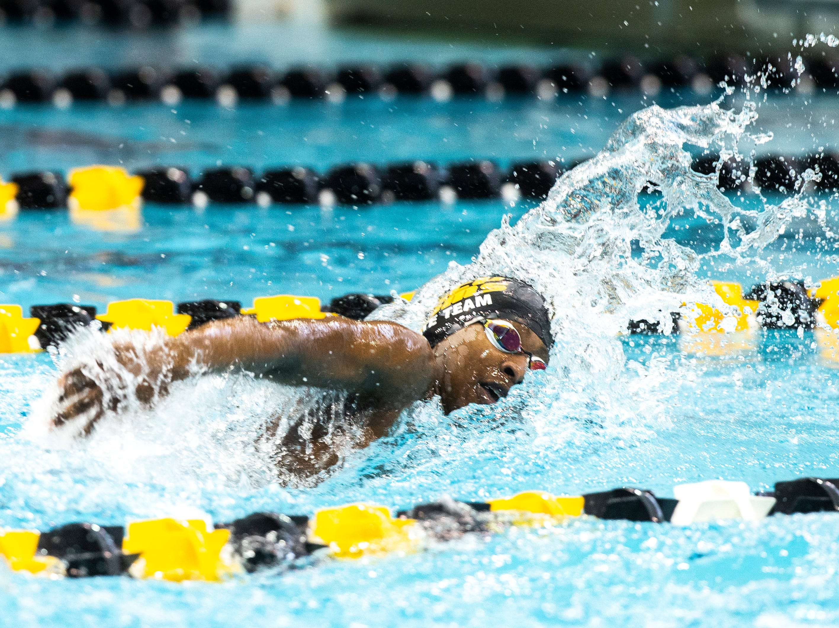 Southeast Polk  senior Will Toomey competes in the 100 yard freestyle during the Iowa boys' state swimming regional championship meet on Saturday, Feb. 9, 2019 at Campus Recreation and Wellness Center on the University of Iowa campus in Iowa City, Iowa. Toomey finished 22nd overall, with a time of 48.73.