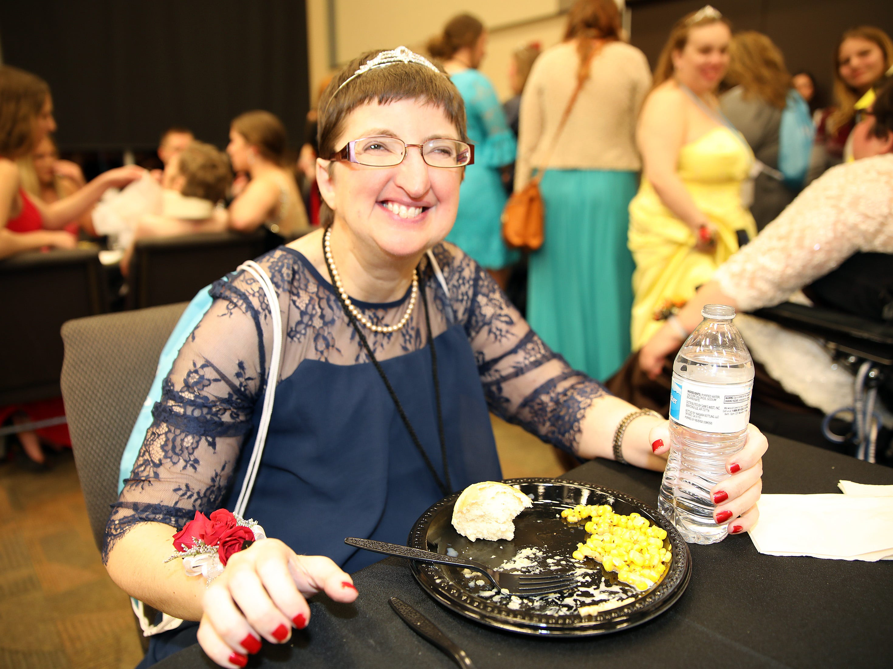 Angie Pickett of Ankeny enjoys dinner during the Night to Shine event at Prairie Ridge Church in Ankeny on Friday, Feb. 8, 2019. Sponsored by the Tim Tebow Foundation, the event for adults with special needs features a prom-like atmosphere with dancing, limo rides, food and more.