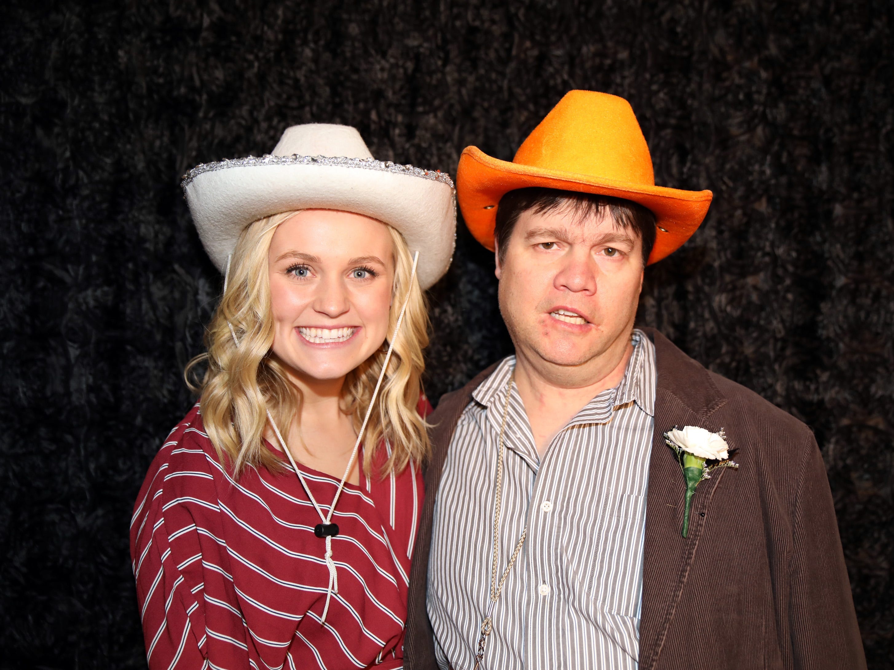Haddie Carlson and Pat Myer stop by the photo booth during the Night to Shine event at Prairie Ridge Church in Ankeny on Friday, Feb. 8, 2019. Sponsored by the Tim Tebow Foundation, the event for adults with special needs features a prom-like atmosphere with dancing, limo rides, food and more.