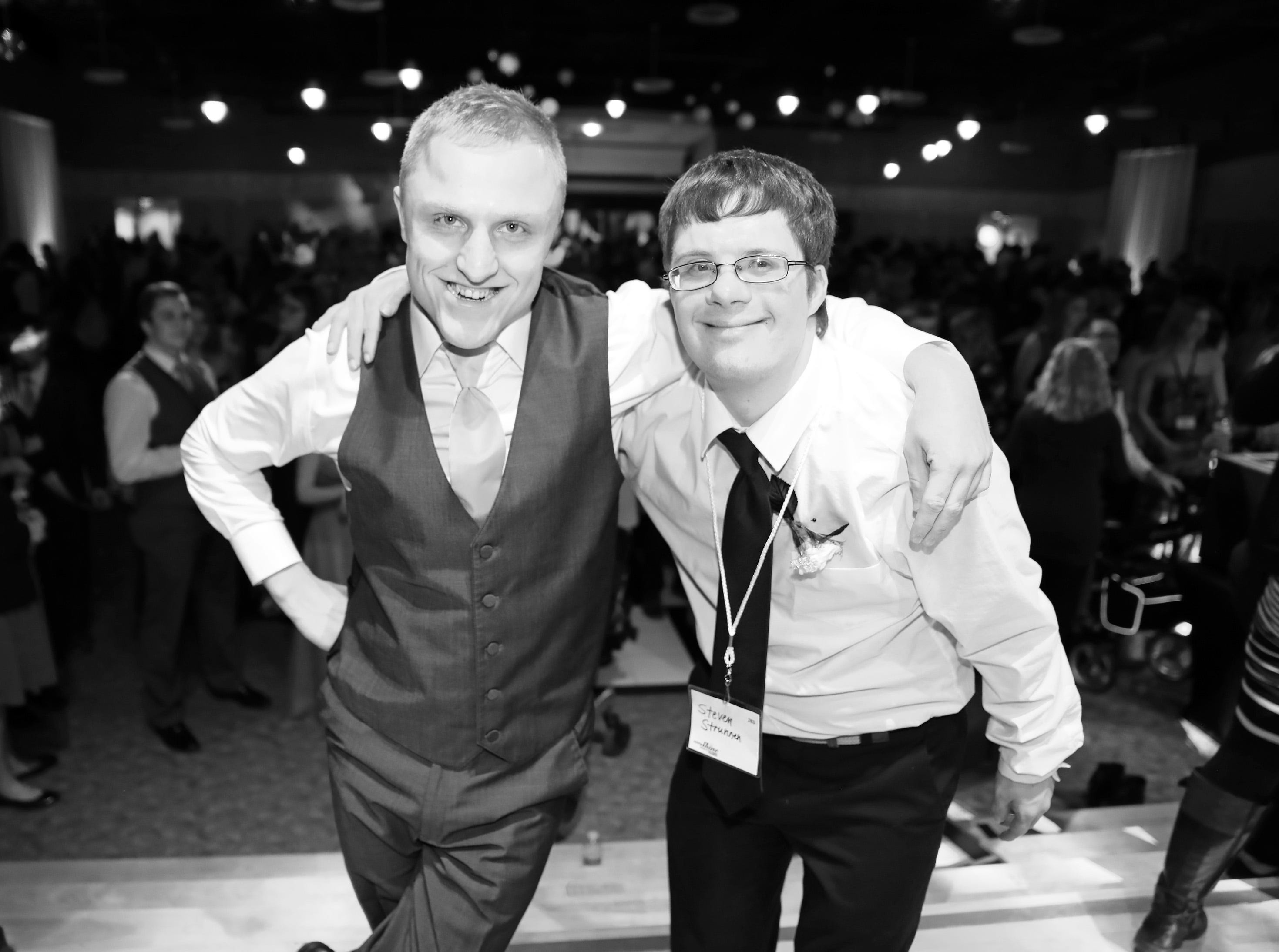 Cole Quinlin, left, and Steven Strennen of Ankeny take a short break from the dance floor during the Night to Shine event at Prairie Ridge Church in Ankeny on Friday, Feb. 8, 2019. Sponsored by the Tim Tebow Foundation, the event for adults with special needs features a prom-like atmosphere with dancing, limo rides, food and more.