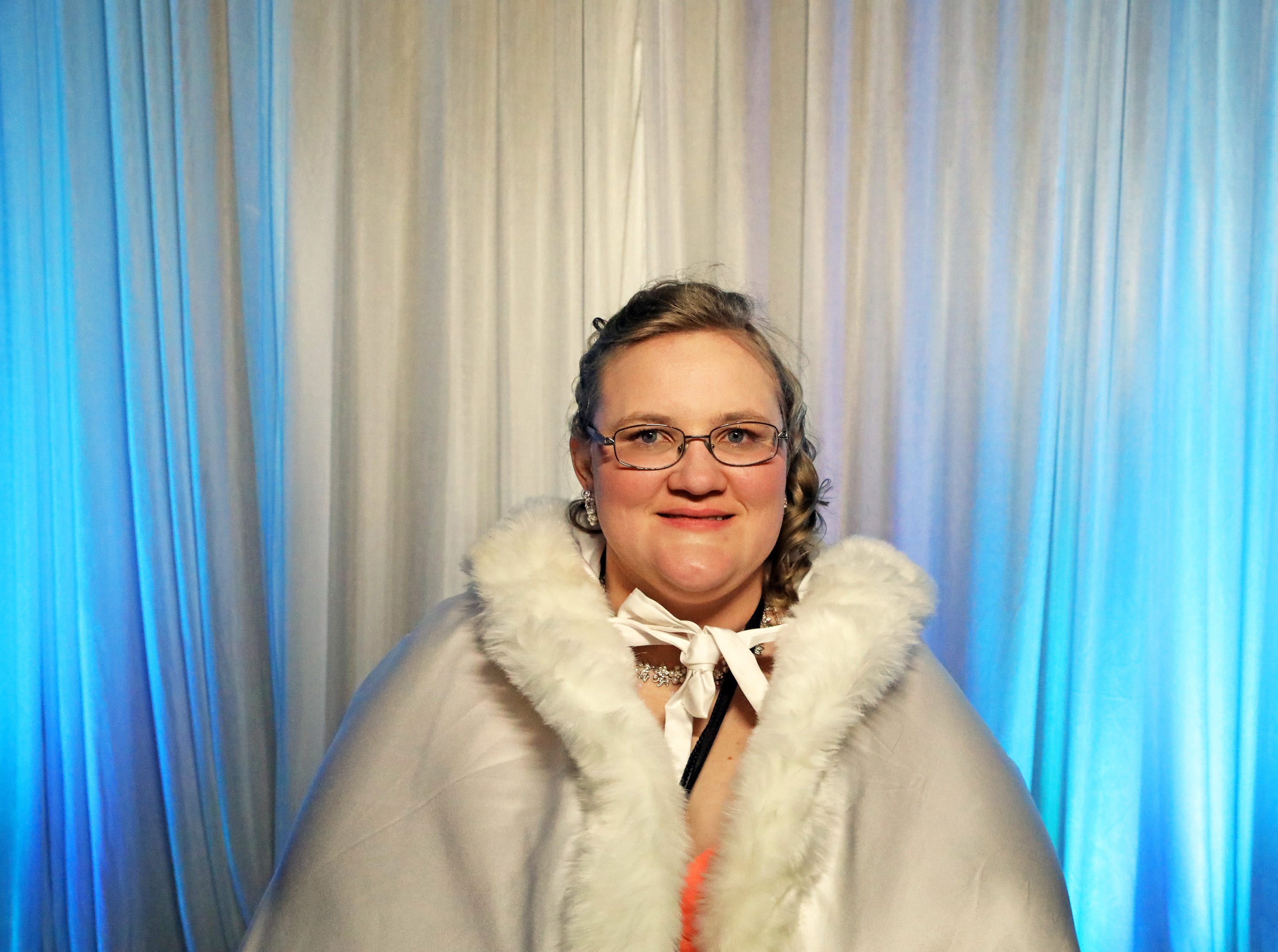 Amber Stukenholtz of Ames sits for her royal portrait during the Night to Shine event at Prairie Ridge Church in Ankeny on Friday, Feb. 8, 2019. Sponsored by the Tim Tebow Foundation, the event for adults with special needs features a prom-like atmosphere with dancing, limo rides, food and more.