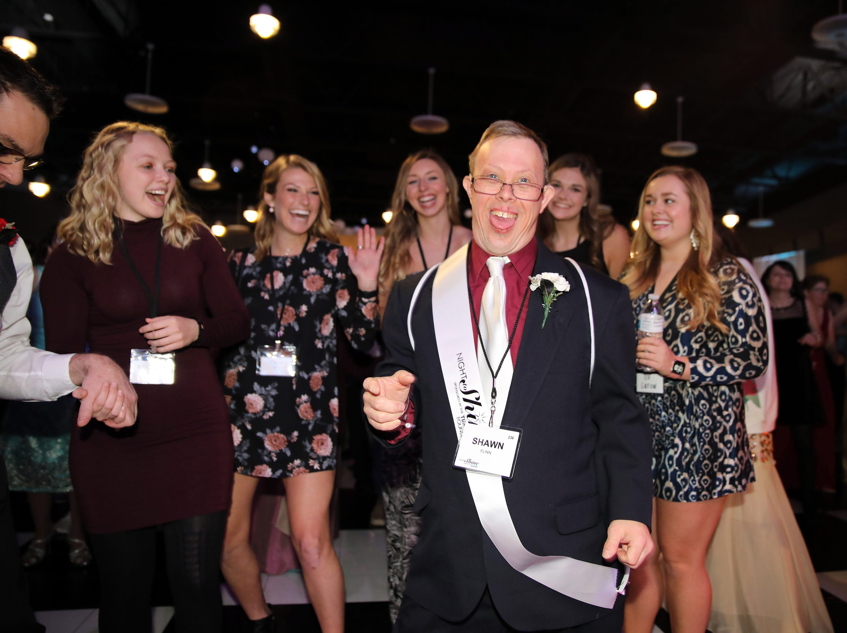 Shawn Flinn dances as the Cupid Shuffle plays during the Night to Shine event at Prairie Ridge Church in Ankeny on Friday, Feb. 8, 2019. Sponsored by the Tim Tebow Foundation, the event for adults with special needs features a prom-like atmosphere with dancing, limo rides, food and more.