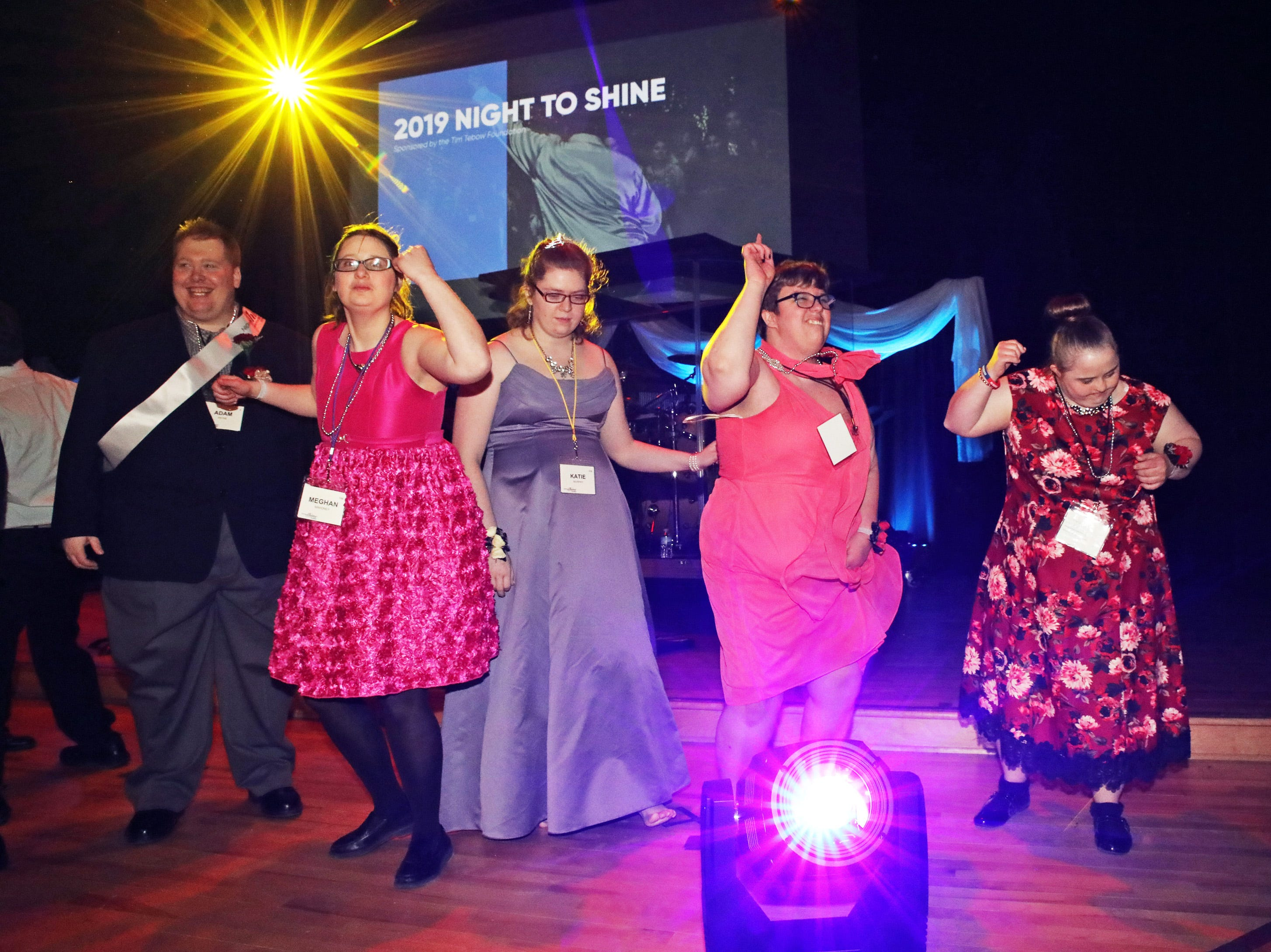 The dance party continues during the Night to Shine event at Prairie Ridge Church in Ankeny on Friday, Feb. 8, 2019. Sponsored by the Tim Tebow Foundation, the event for adults with special needs features a prom-like atmosphere with dancing, limo rides, food and more.