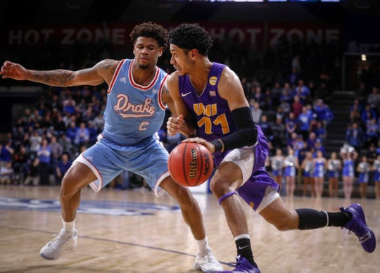 Northern Iowa sophomore Trae Berhow drives in against Drake junior Tremell Murphy in the second half at Drake University in Des Moines in on Saturday, Feb. 9, 2019.