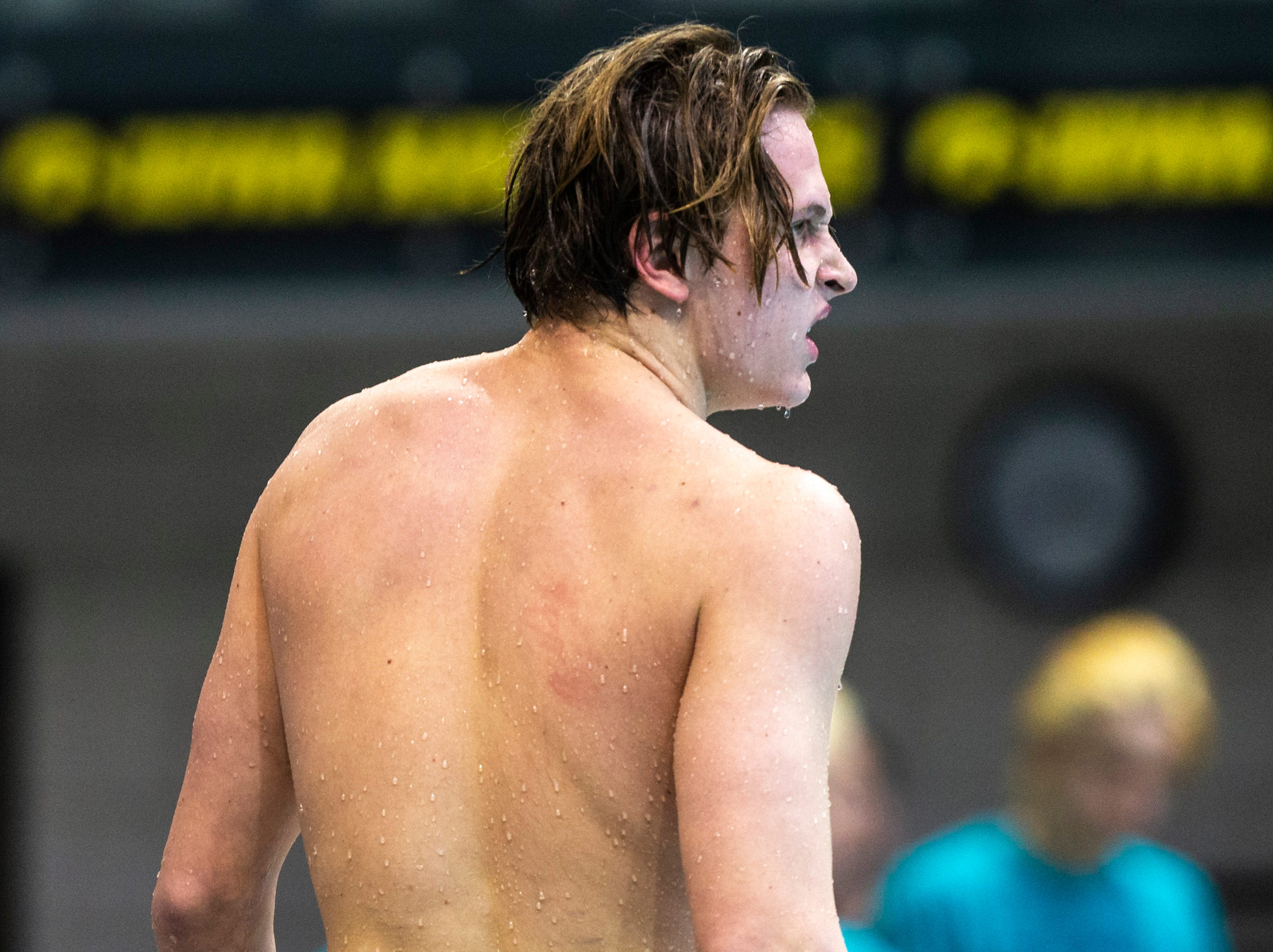 Iowa City High junior Forrest Frazier walks on the deck after winning the third heat of 100 yard breaststroke during the Iowa boys' state swimming regional championship meet on Saturday, Feb. 9, 2019 at Campus Recreation and Wellness Center on the University of Iowa campus in Iowa City, Iowa. Frazier finished first overall, with a time of 55.17.