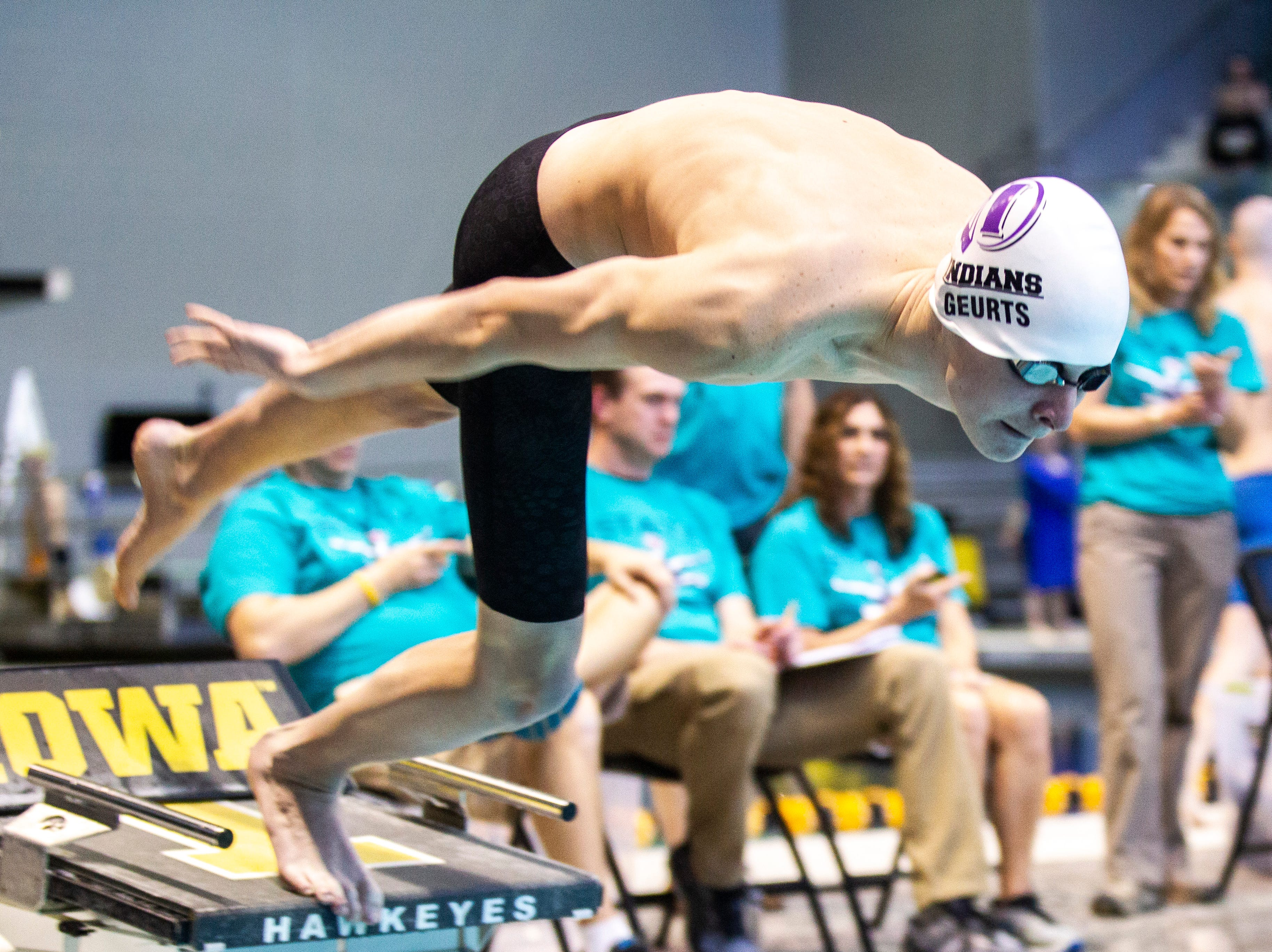 Indianola junior Collin Geurts leaps off the blocks while competing in the 200 yard freestyle during the Iowa boys' state swimming regional championship meet on Saturday, Feb. 9, 2019 at Campus Recreation and Wellness Center on the University of Iowa campus in Iowa City, Iowa. Geurts finished 21st overall, with a time of 1:48.64.