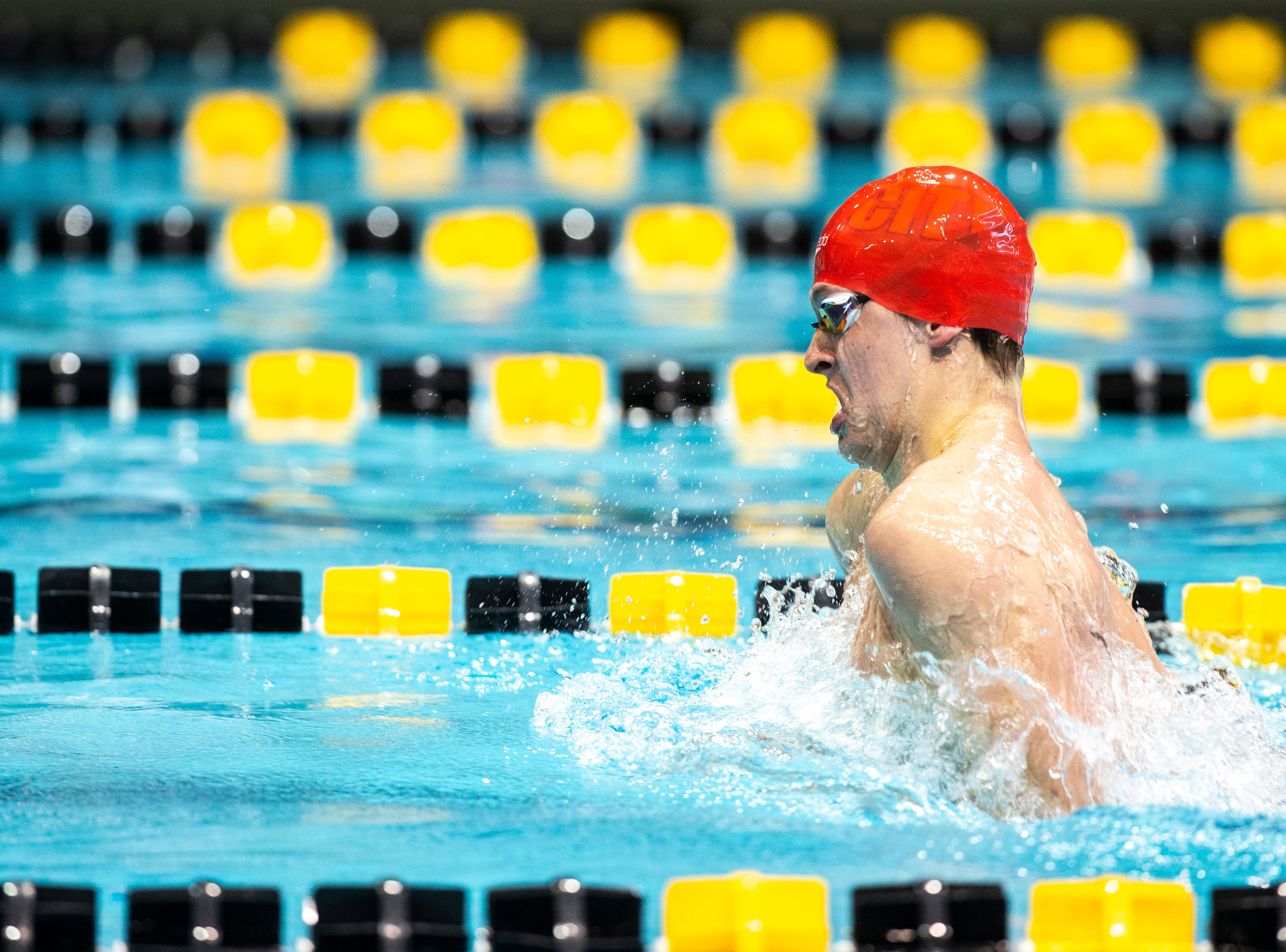 Iowa City High junior Forrest Frazier competes in the third heat of 100 yard breaststroke during the Iowa boys' state swimming regional championship meet on Saturday, Feb. 9, 2019 at Campus Recreation and Wellness Center on the University of Iowa campus in Iowa City, Iowa. Frazier finished first overall, with a time of 55.17.