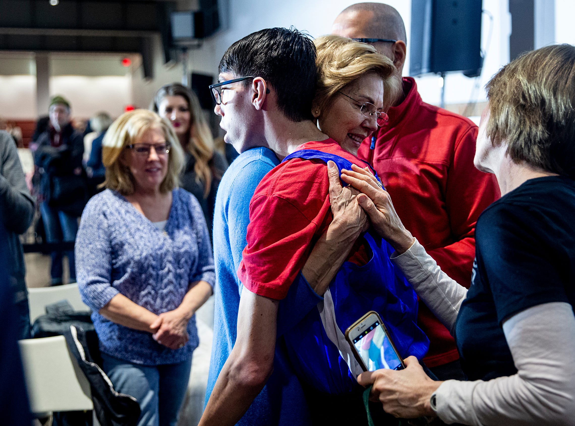 Sen. Elizabeth Warren, D-Mass, hugs a man attending her campaign stop on Sunday, Feb. 10, 2019, in the Veterans Memorial Building in downtown Cedar Rapids.