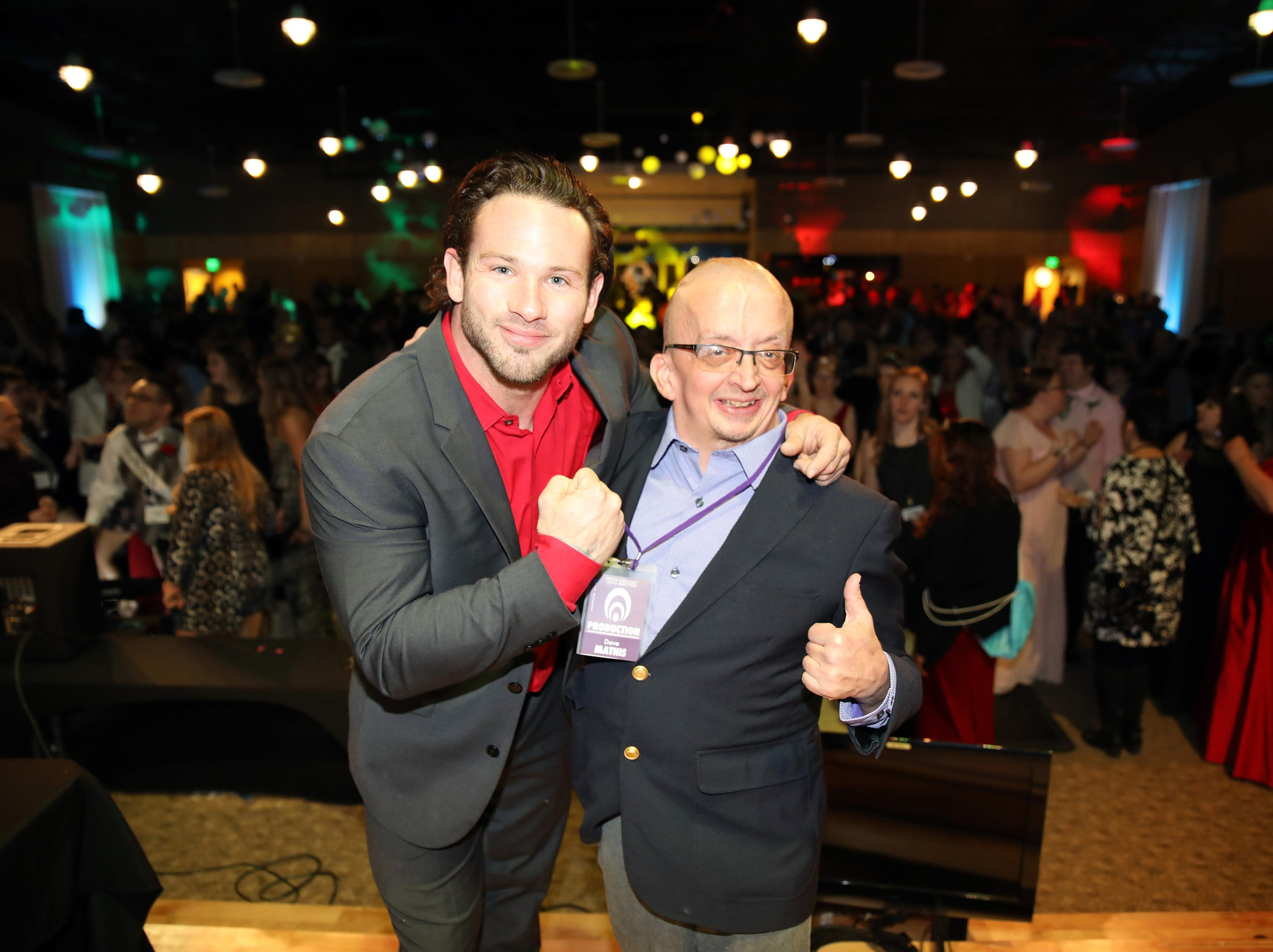 Joe Hogan of Train to Inspire and Dave Mathis of Altoona stop for a photo during the Night to Shine event at Prairie Ridge Church in Ankeny on Friday, Feb. 8, 2019. Sponsored by the Tim Tebow Foundation, the event for adults with special needs features a prom-like atmosphere with dancing, limo rides, food and more.