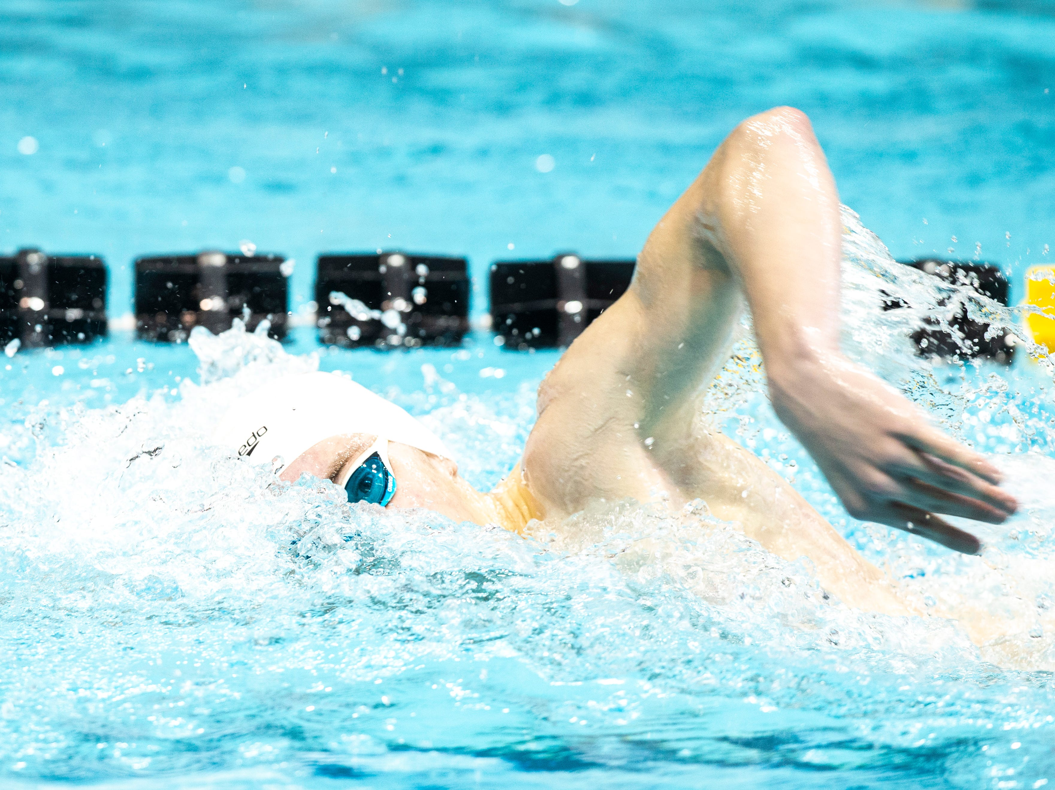 Iowa City High sophomore Isaac Weigel competes in the second heat of 500 yard freestyle during the Iowa boys' state swimming regional championship meet on Saturday, Feb. 9, 2019 at Campus Recreation and Wellness Center on the University of Iowa campus in Iowa City, Iowa. Weigel finished fourth overall, with a time of 4:38.40.