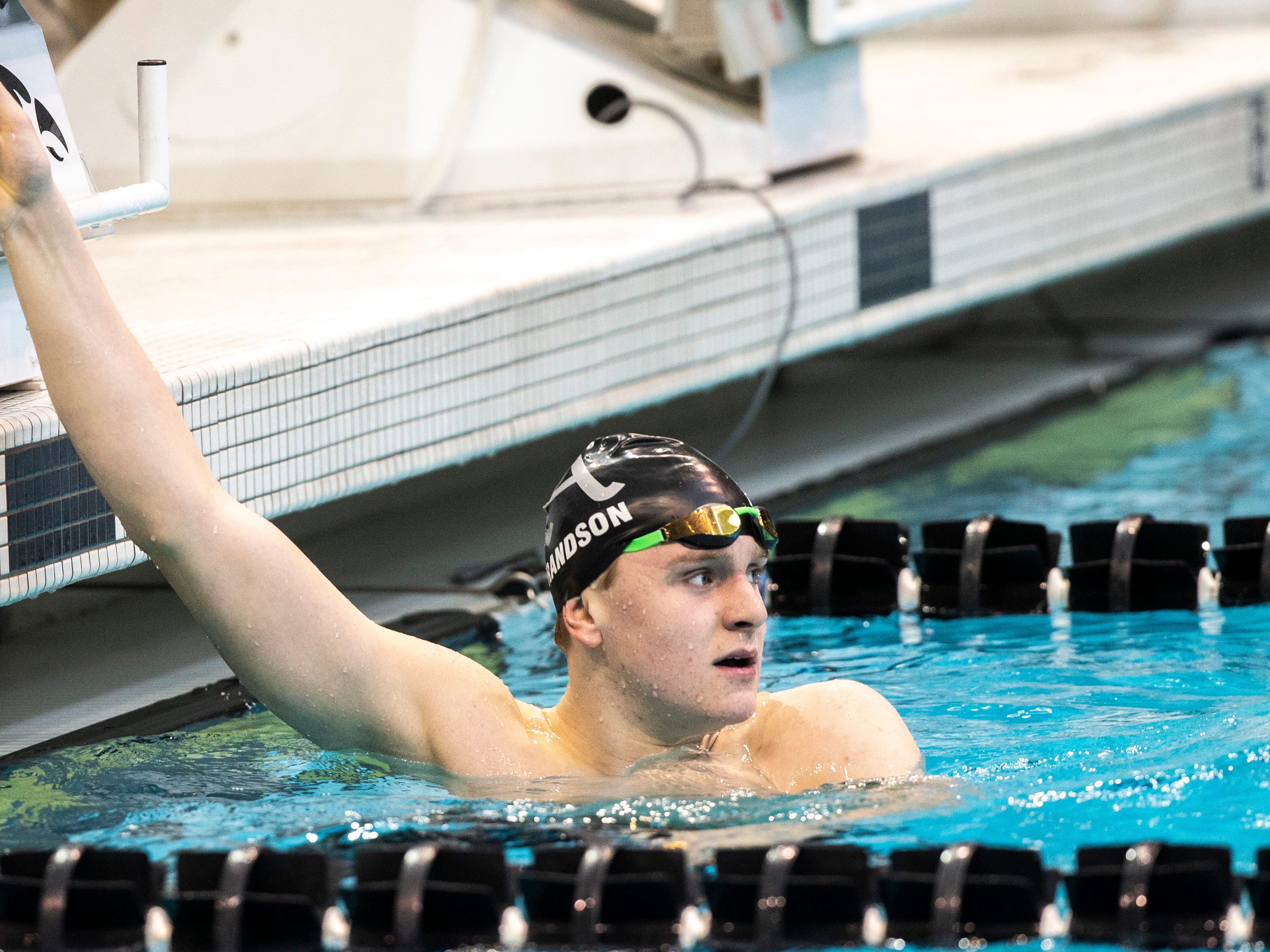 Ankeny sophomore Trent Frandson looks to the scoreboard after winning the third heat of the 500 yard freestyle during the Iowa boys' state swimming regional championship meet on Saturday, Feb. 9, 2019 at Campus Recreation and Wellness Center on the University of Iowa campus in Iowa City, Iowa. Frandson set a state record with his first place finish, with a time of 4:23.46.