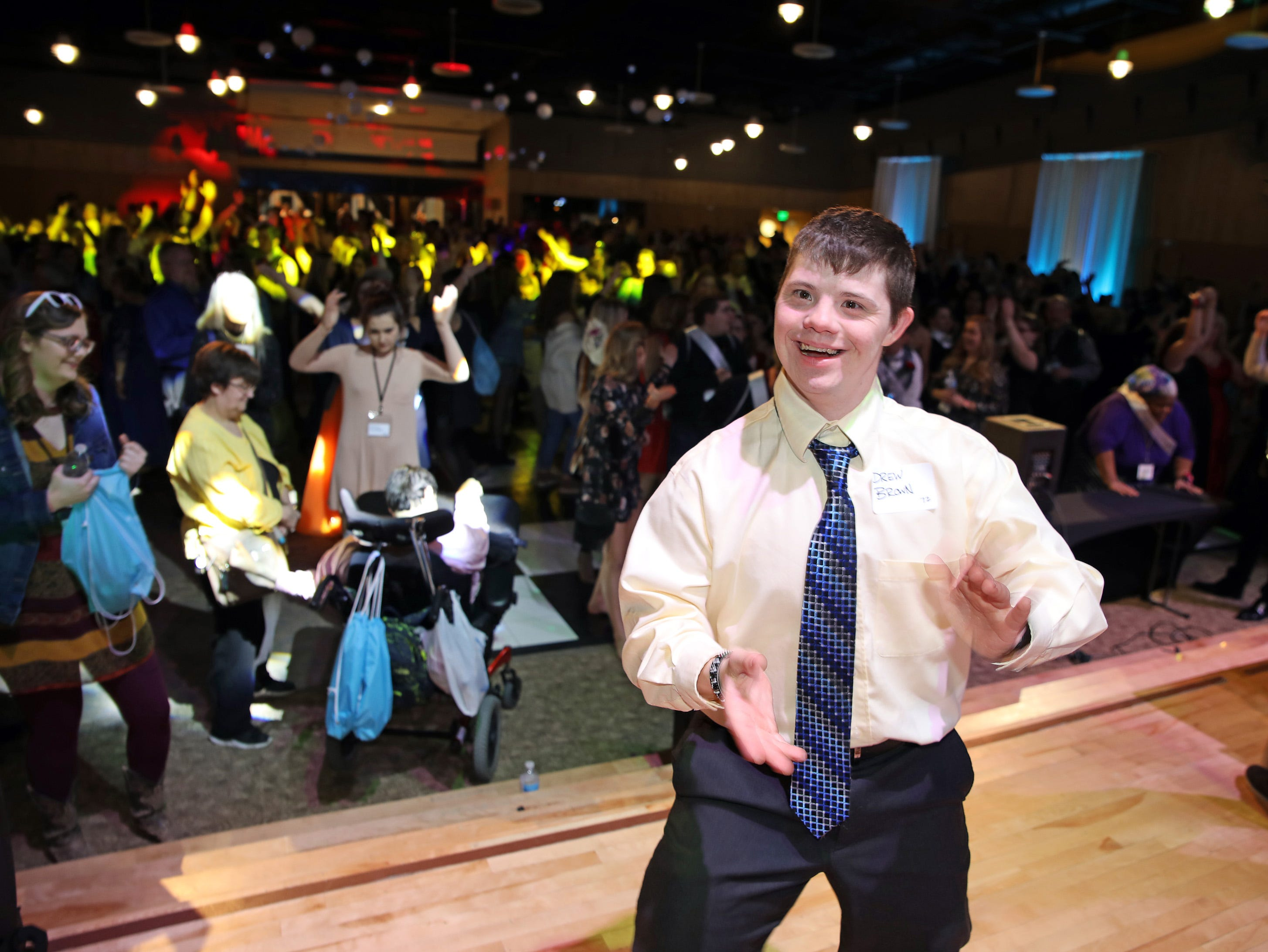 Drew Brown of Ankeny enjoys dancing at the Night to Shine event at Prairie Ridge Church in Ankeny on Friday, Feb. 8, 2019. Sponsored by the Tim Tebow Foundation, the event for adults with special needs features a prom-like atmosphere with dancing, limo rides, food and more.