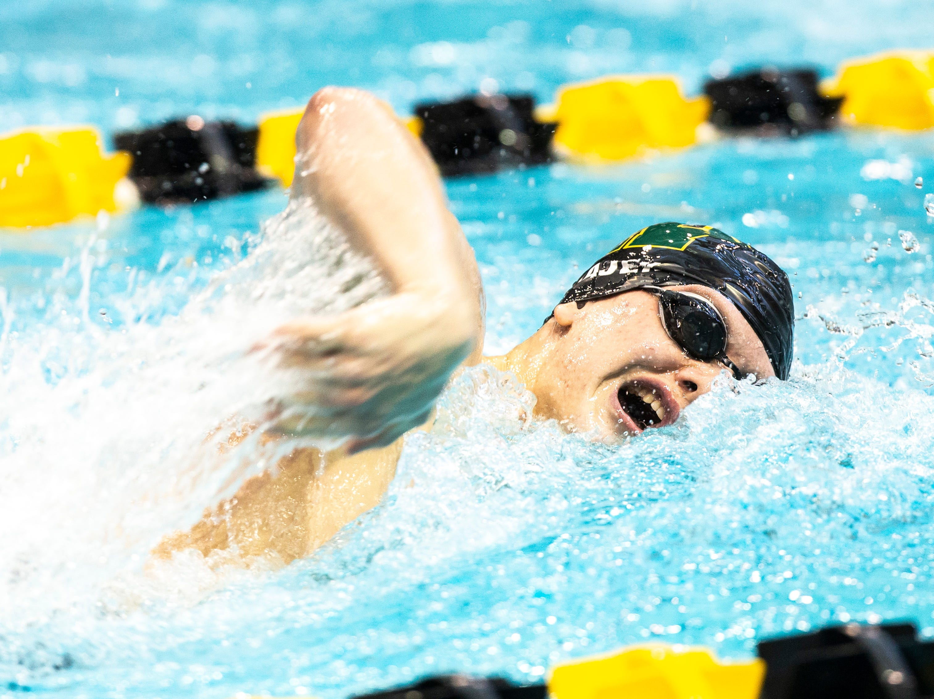 Iowa City West junior Izaak Hajek competes in the 200 yard individual medley during the Iowa boys' state swimming regional championship meet on Saturday, Feb. 9, 2019 at Campus Recreation and Wellness Center on the University of Iowa campus in Iowa City, Iowa. Hajek finished fifth overall, with a time of 1:55.52.