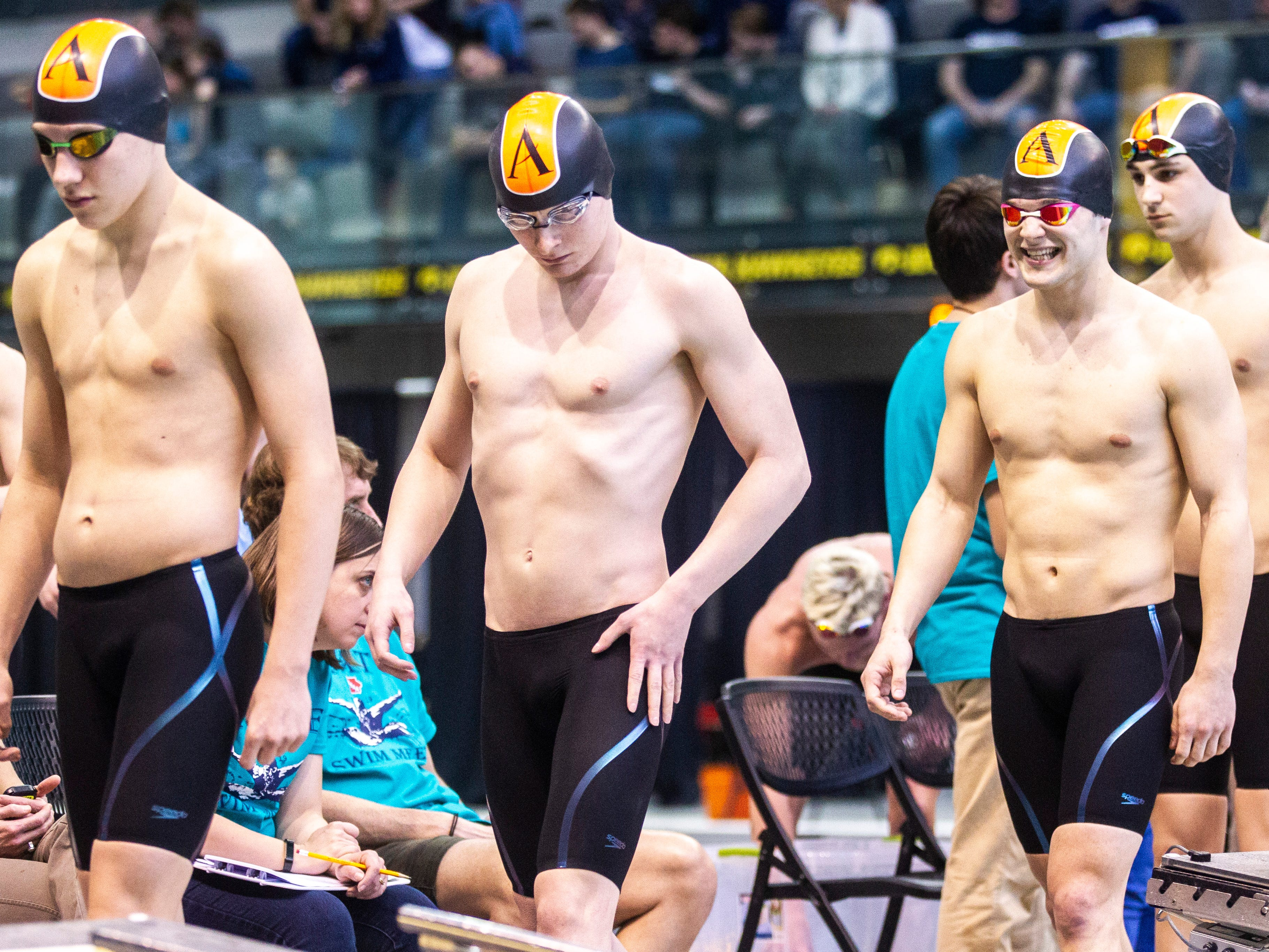 Ames' 200 yard freestyle relay is introduced during the Iowa boys' state swimming regional championship meet on Saturday, Feb. 9, 2019 at Campus Recreation and Wellness Center on the University of Iowa campus in Iowa City, Iowa.