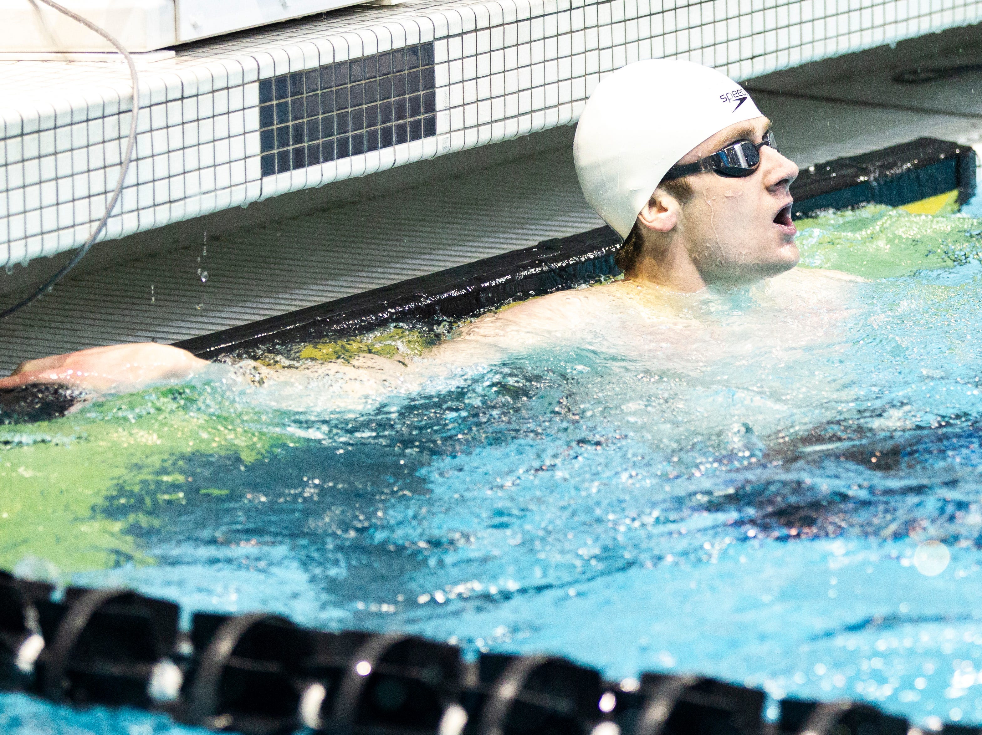 Dowling Catholic senior Nick Chase looks at the scoreboard after finish first in the third heat of 100 yard backstroke during the Iowa boys' state swimming regional championship meet on Saturday, Feb. 9, 2019 at Campus Recreation and Wellness Center on the University of Iowa campus in Iowa City, Iowa. Chase finished first overall, with a time of 50.10.
