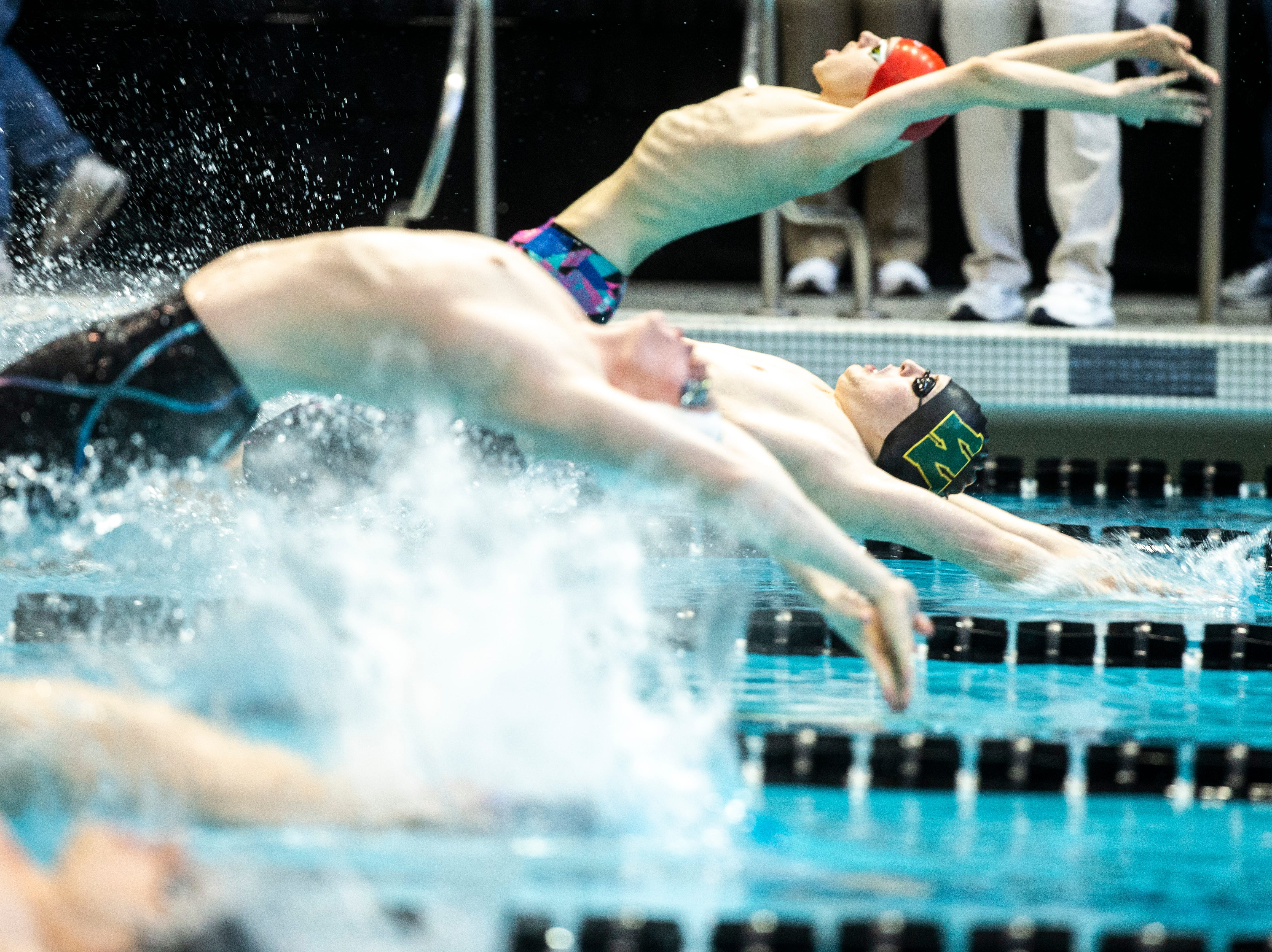 Iowa City West junior James Pinter leaps off the blocks at the start of the 200 yard medley relay during the Iowa boys' state swimming regional championship meet on Saturday, Feb. 9, 2019 at Campus Recreation and Wellness Center on the University of Iowa campus in Iowa City, Iowa. West High finished second, with a time of 1:34.75.