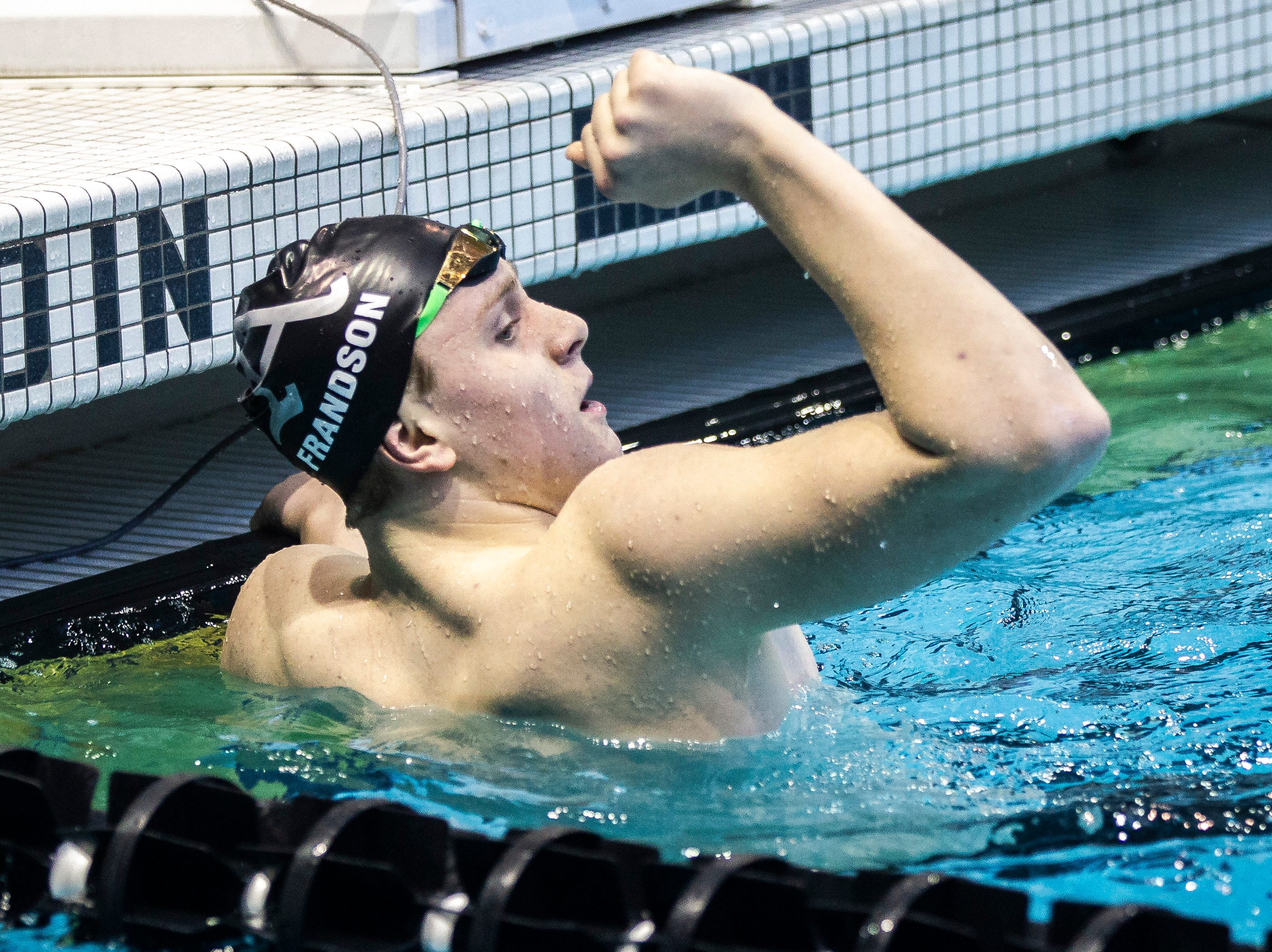 Ankeny sophomore Trent Frandson celebrates after winning the third heat of the 200 yard freestyle during the Iowa boys' state swimming regional championship meet on Saturday, Feb. 9, 2019 at Campus Recreation and Wellness Center on the University of Iowa campus in Iowa City, Iowa. Frandson finished first overall, with a time of 1:37.75.
