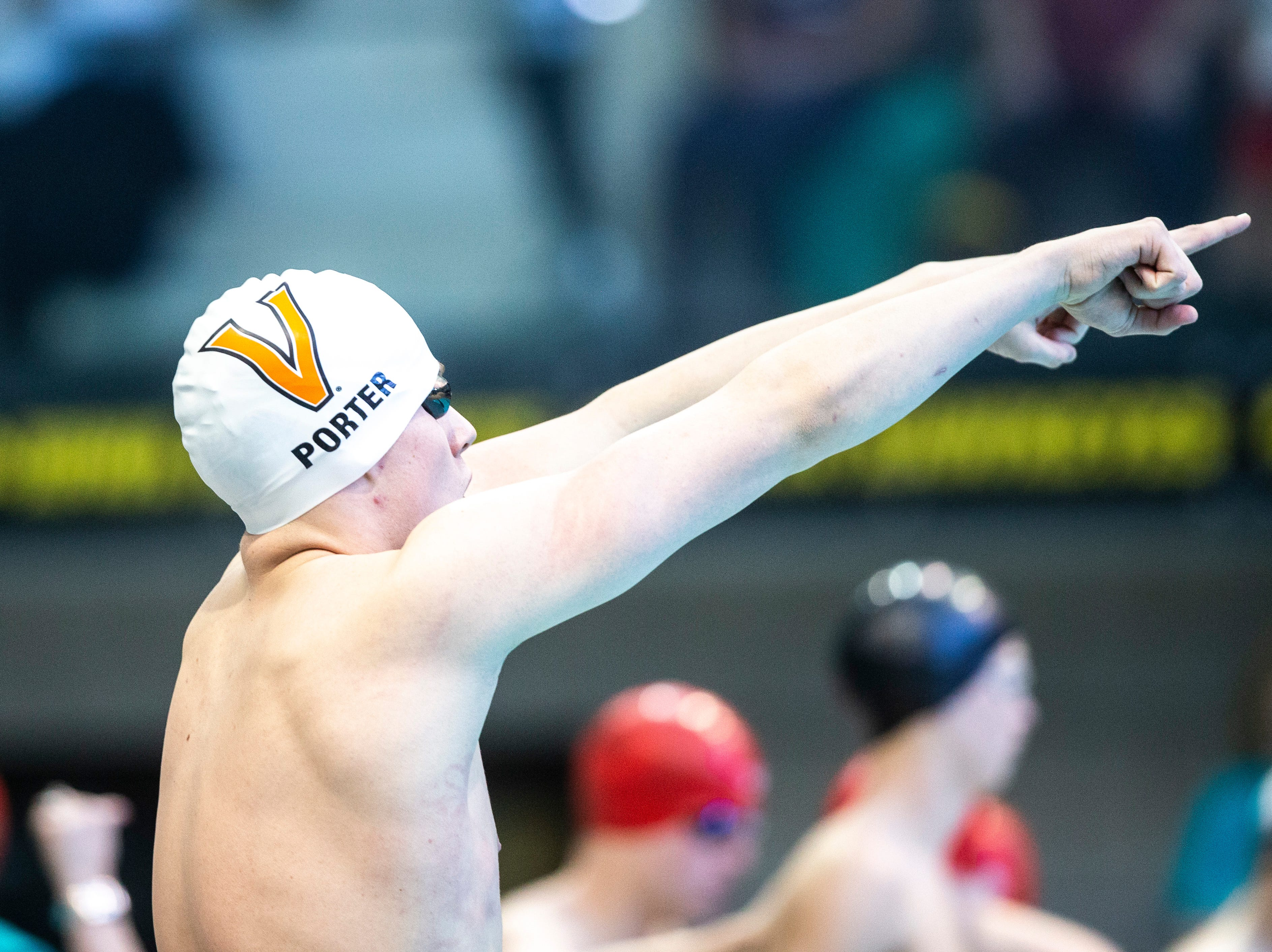 West Des Moines Valley senior Evan Porter gestures to fans before the start of the 200 yard medley relay during the Iowa boys' state swimming regional championship meet on Saturday, Feb. 9, 2019 at Campus Recreation and Wellness Center on the University of Iowa campus in Iowa City, Iowa. Valley finished tenth overall, with a time of 1:37.45.