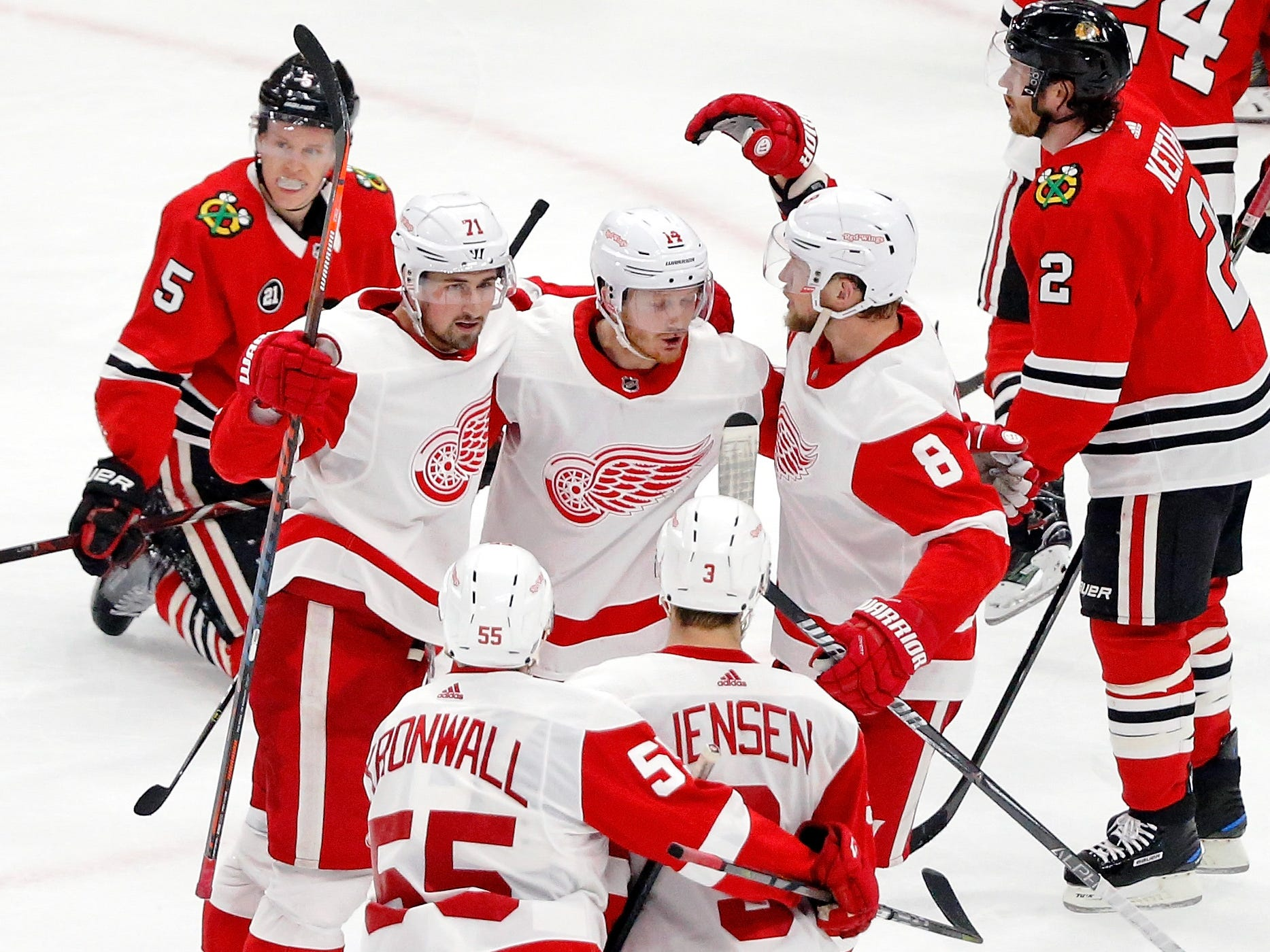 Detroit Red Wings right wing Gustav Nyquist, center, is congratulated by Dylan Larkin (71) and Justin Abdelkader (8) after scoring against the Chicago Blackhawks during the third period Sunday, Feb. 10, 2019.