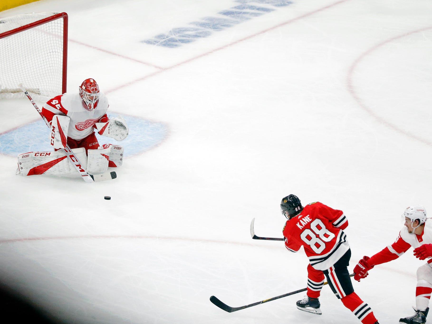 Chicago Blackhawks right wing Patrick Kane scores past Detroit Red Wings goaltender Jonathan Bernier, as defenseman Danny DeKeyser defends during the third period at United Center, Sunday, Feb. 10, 2019.
